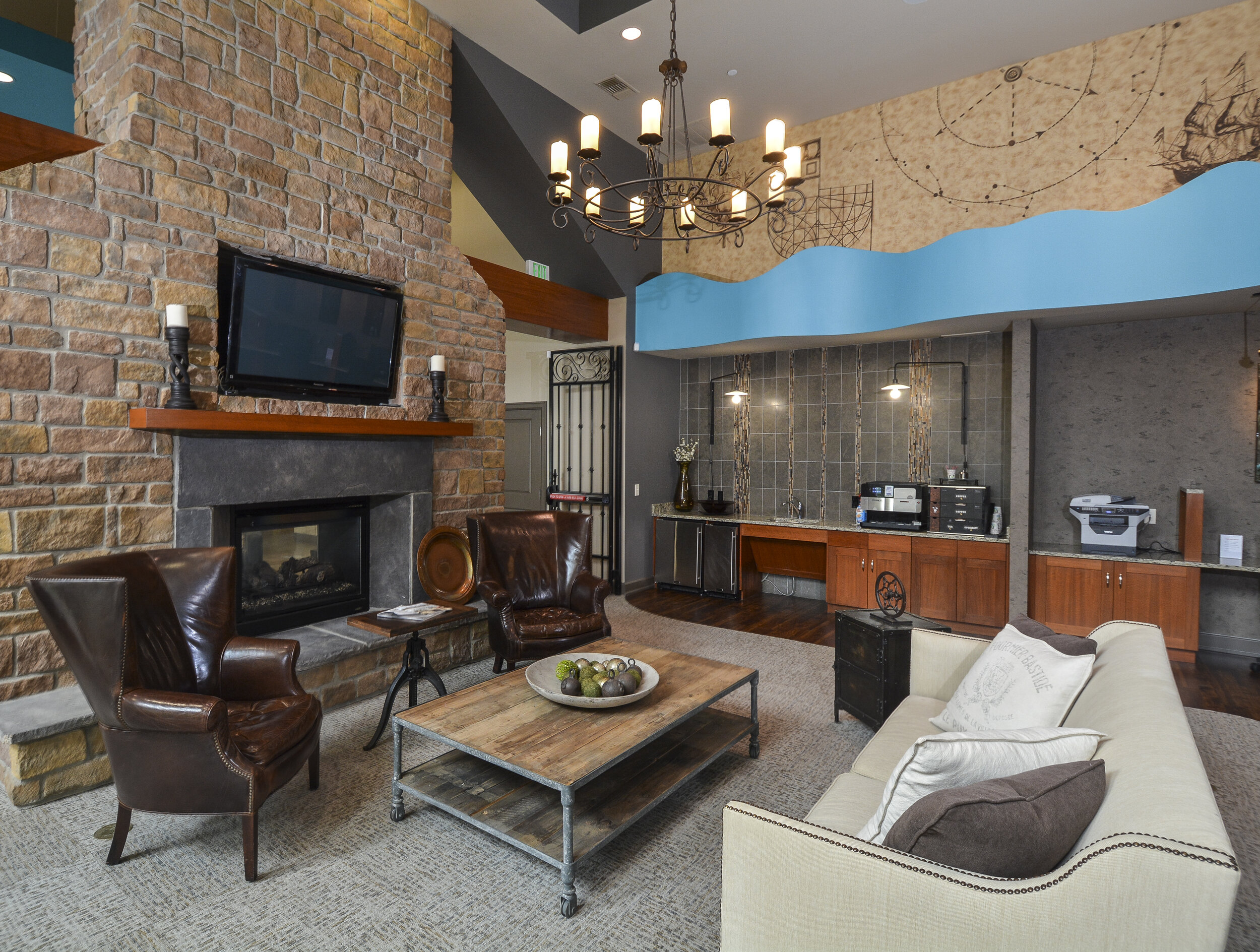 17-Cozy Clubhouse Fireplace With TV _ Coffee Bar.jpg
