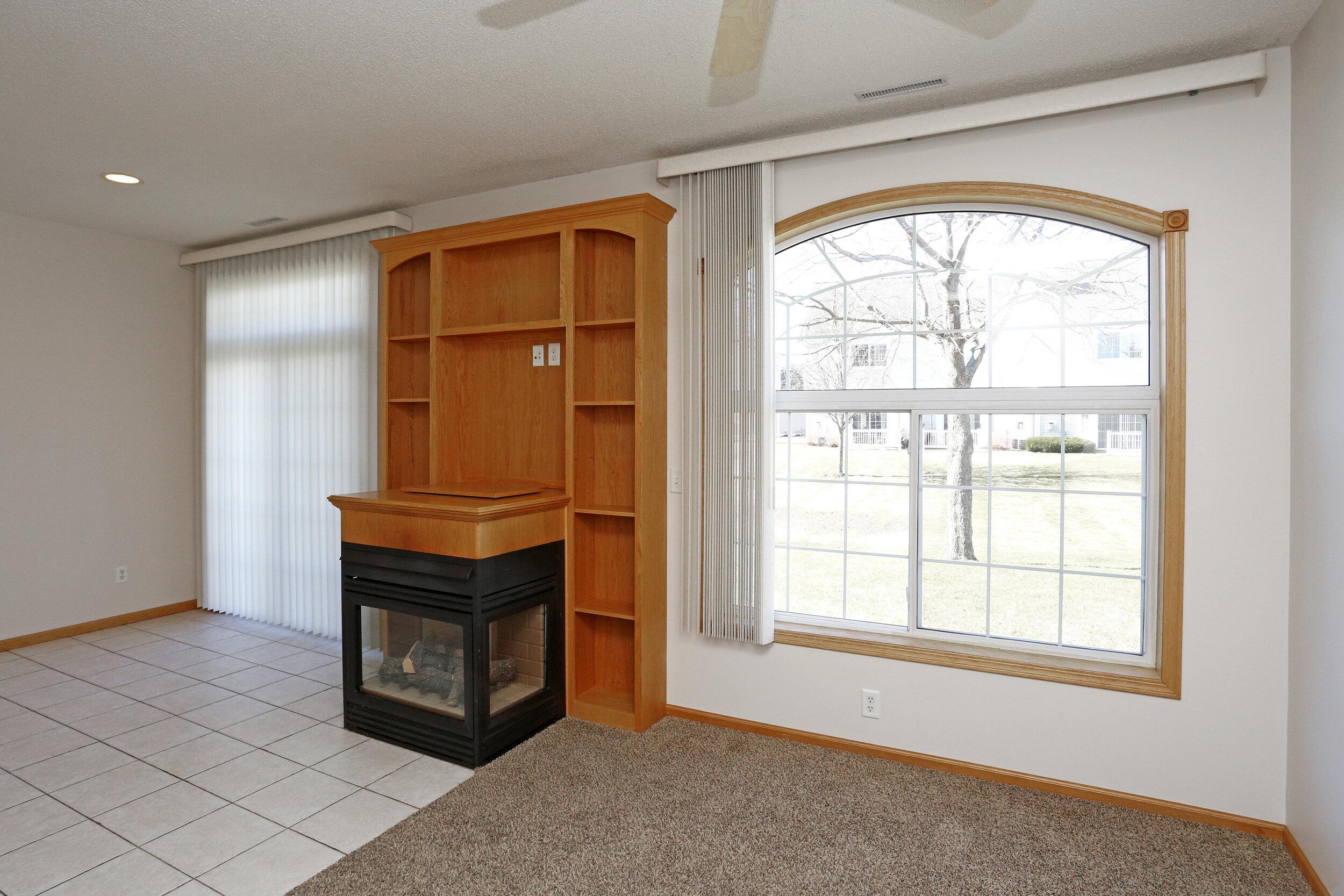 Oversized Windows Provides Natural Light Filling the Living Area