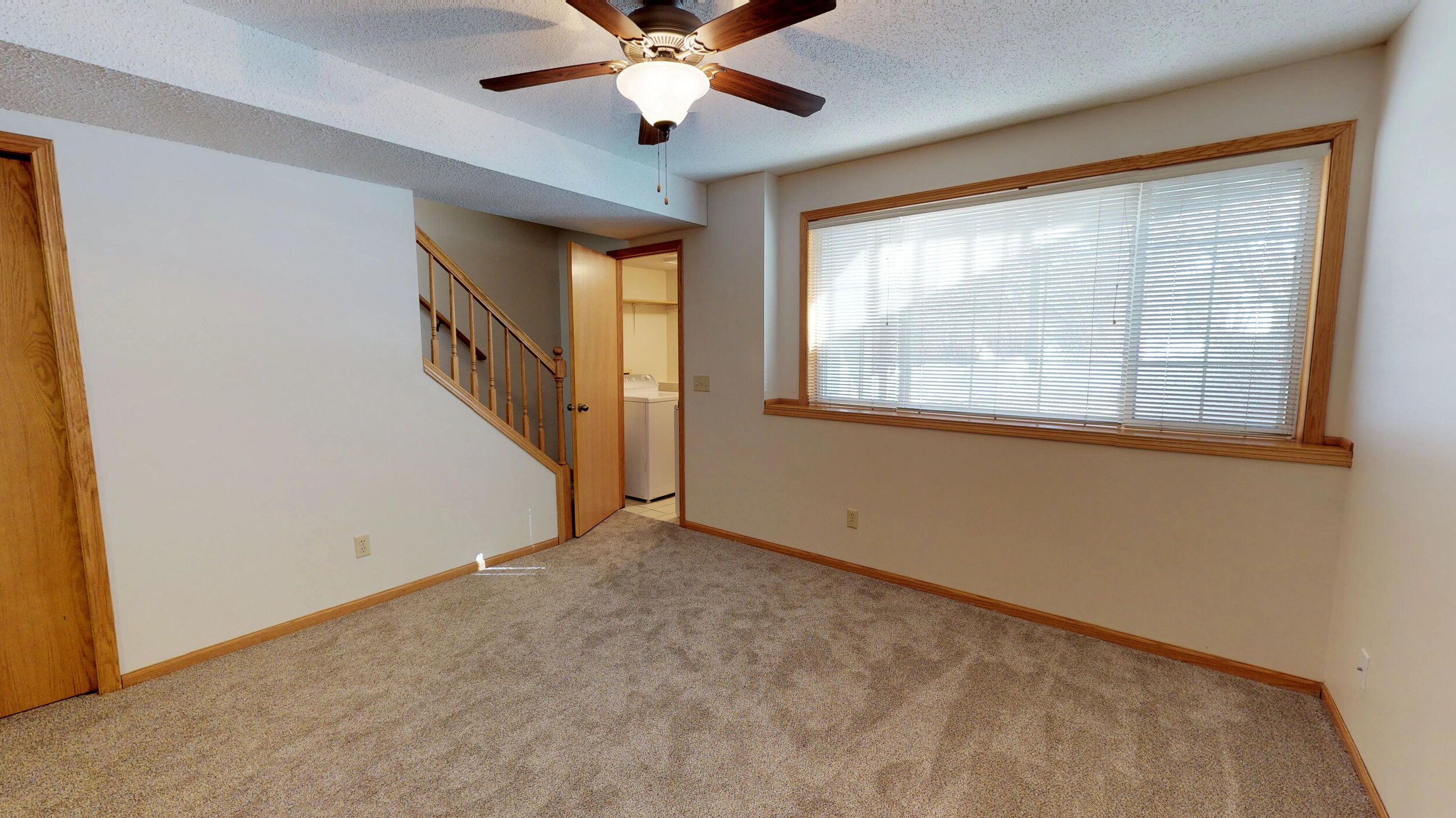 Large Basement Family Room with Separate Washer & Dryer Area