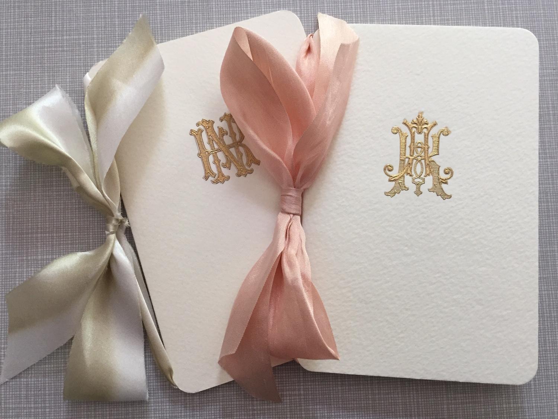 Wedding programs for Nicholas Saban (left) and Kristen Saban (right).