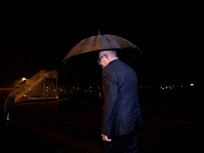 Scott Morrison in the rain.jpg
