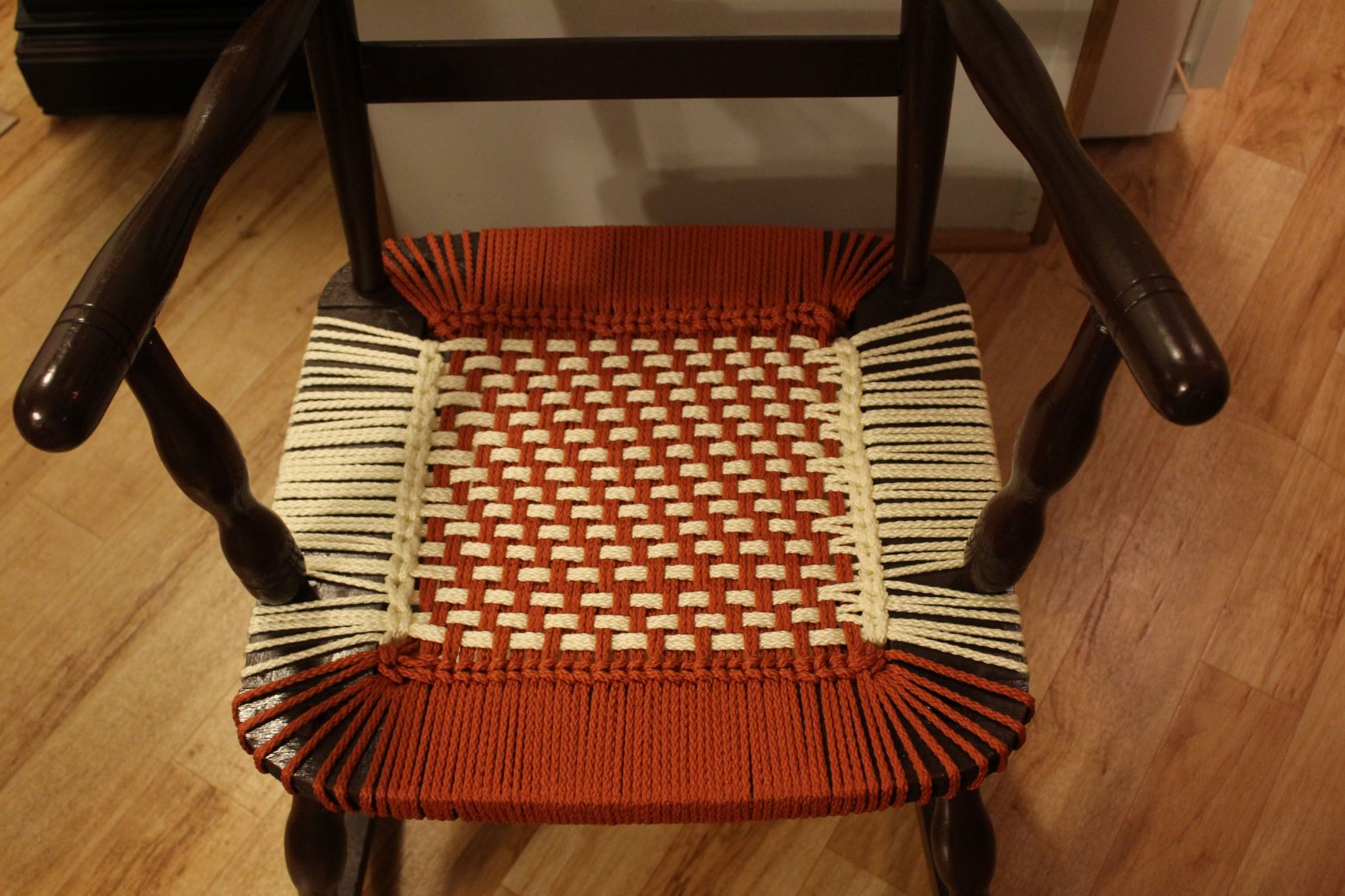 Brown Rocking Chair -- Pueblo Pattern; Rust and Ivory Cord