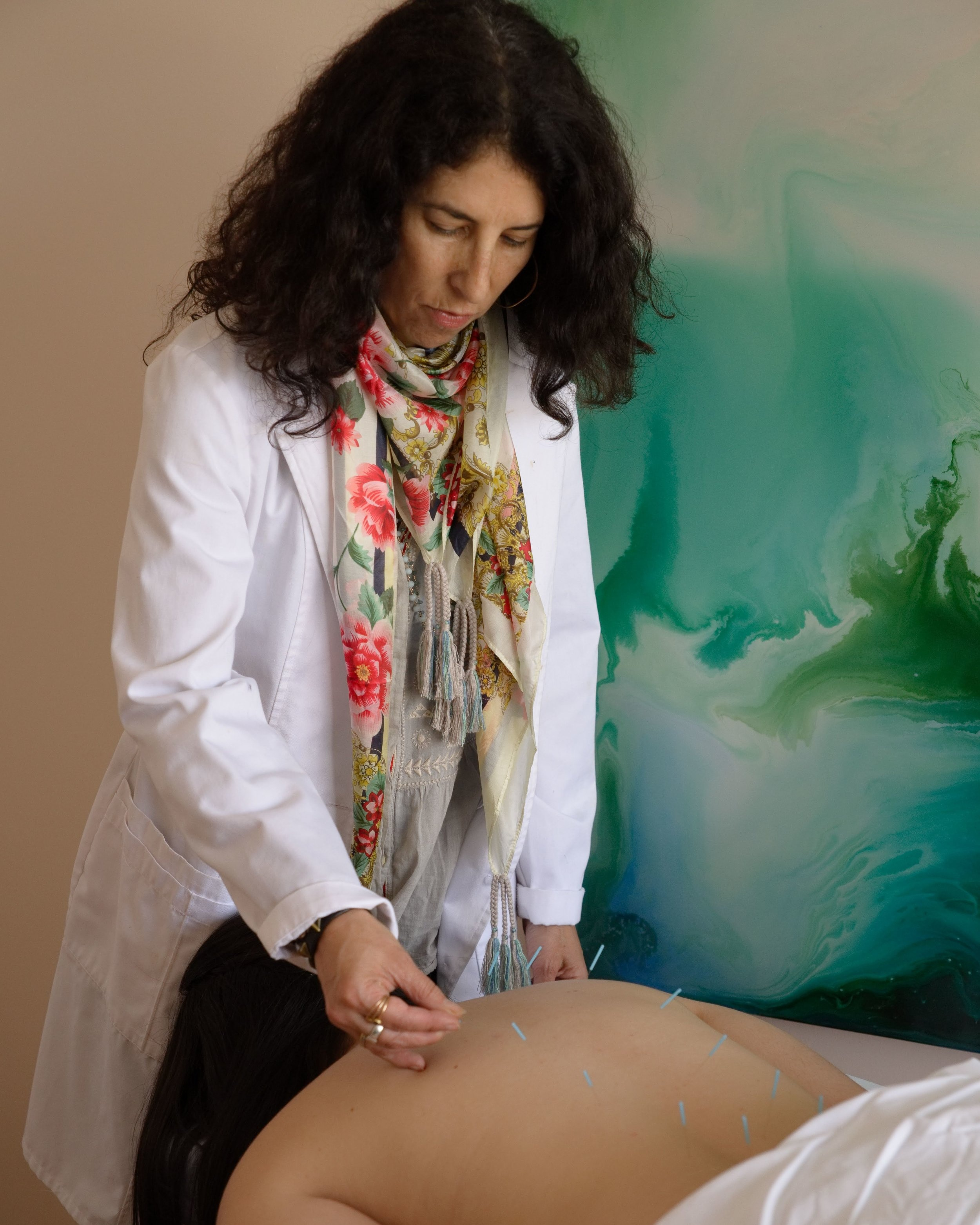 Denise Wiesner, Chinese Medicine Practitioner, performing acupuncture on a patient