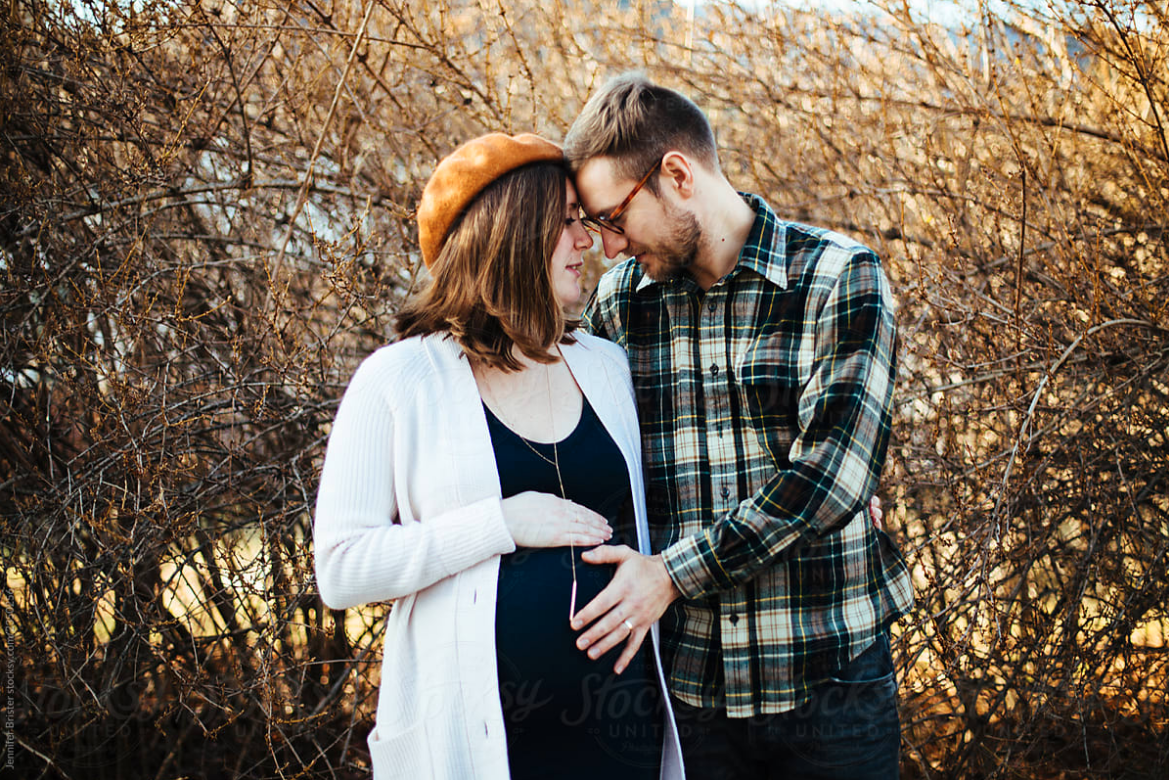 A couple on their pregnancy journey after receiving fertility treatment to conceive.
