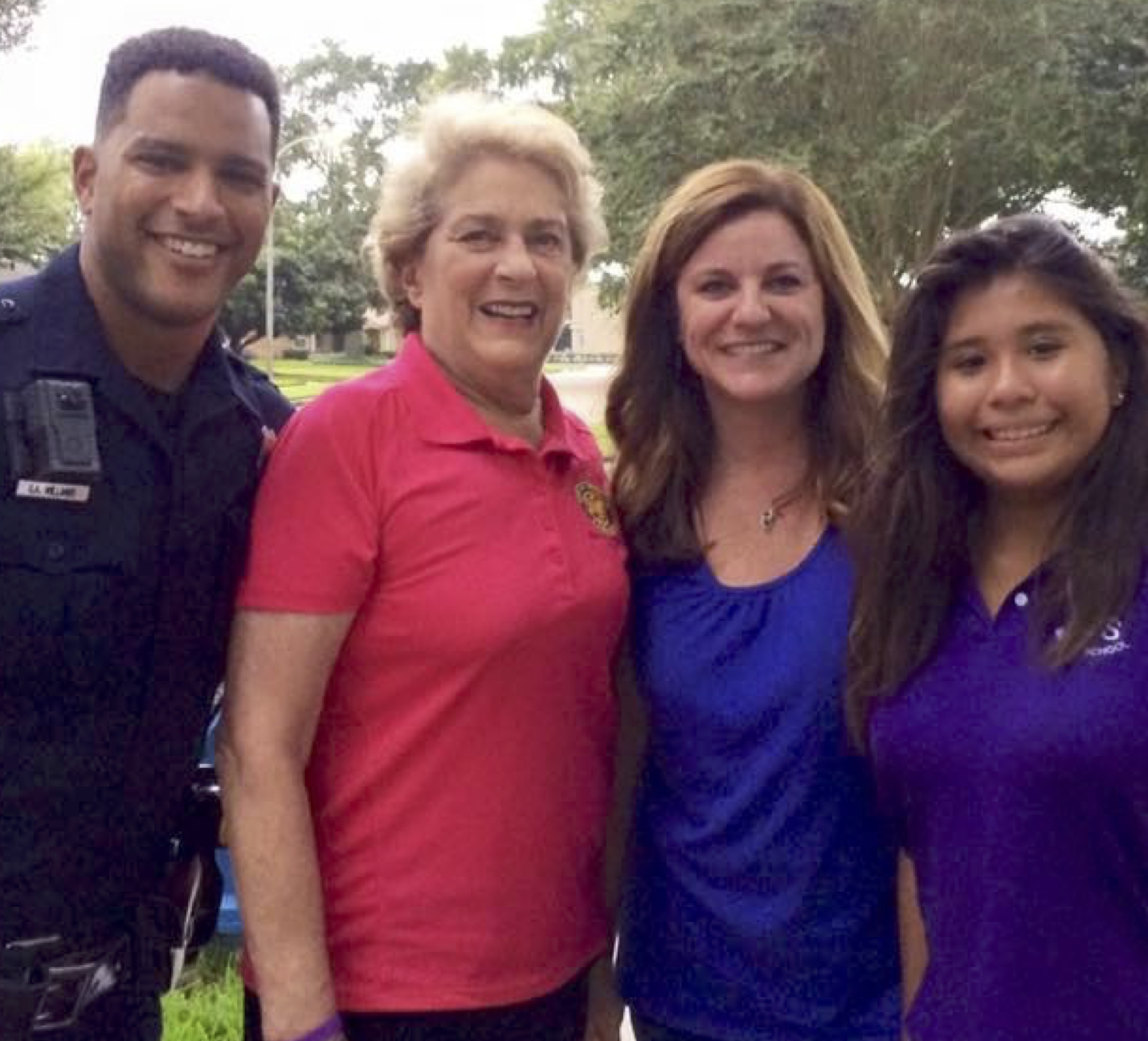 City Council Member Ellen Cohen poses with neighbors and Houston Police Department officer at National Night Out block party on Cindy Ln.