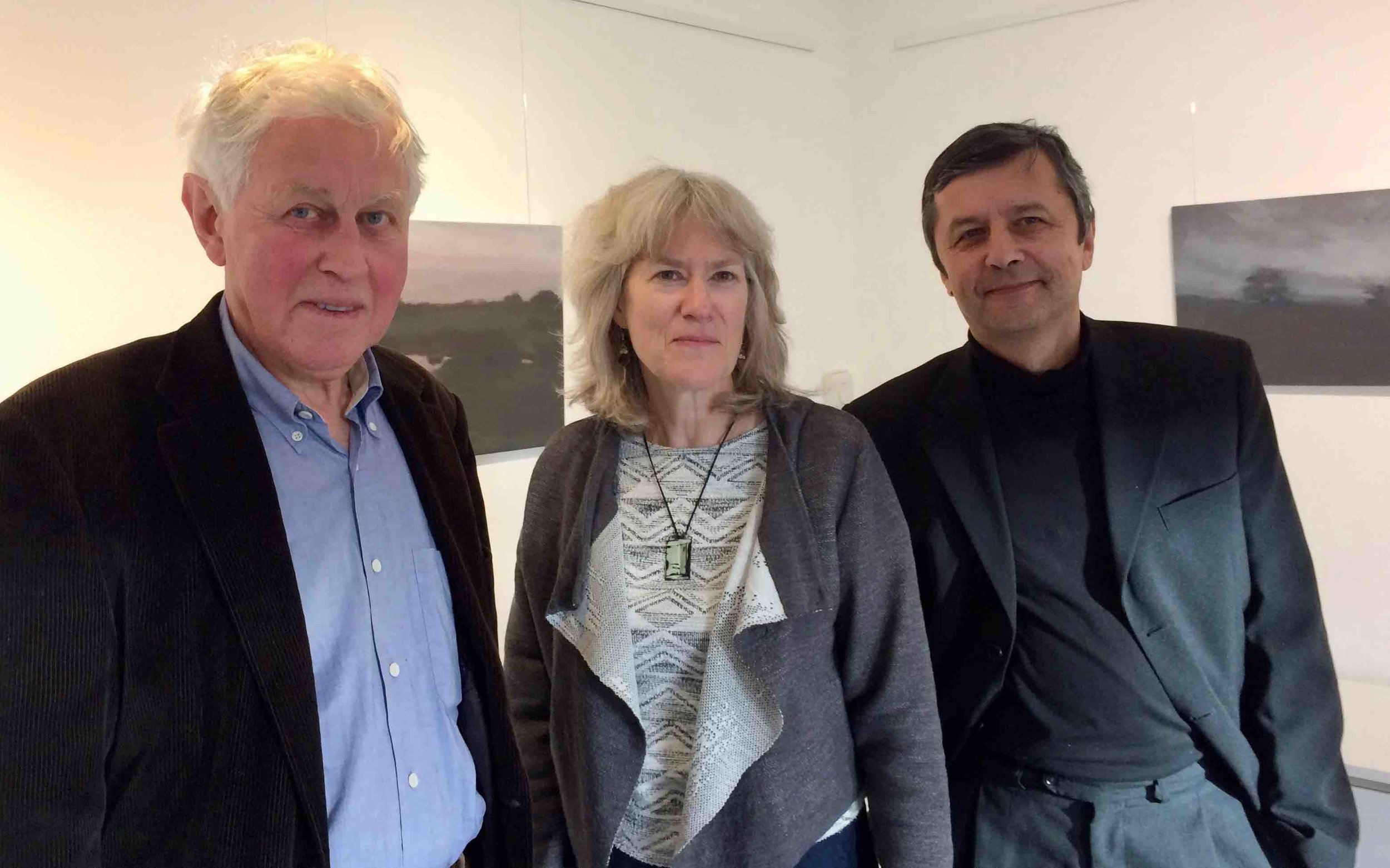 David and Jean with composer/pianist Pavel Novak - London Oct 2017 (w/Jenifer Wakelyn's paintings in the background)