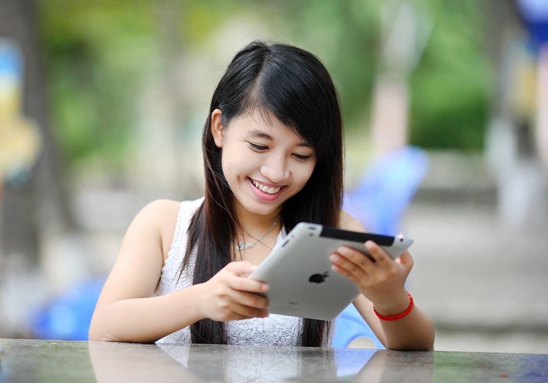 Asian happy girl on ipad.jpeg