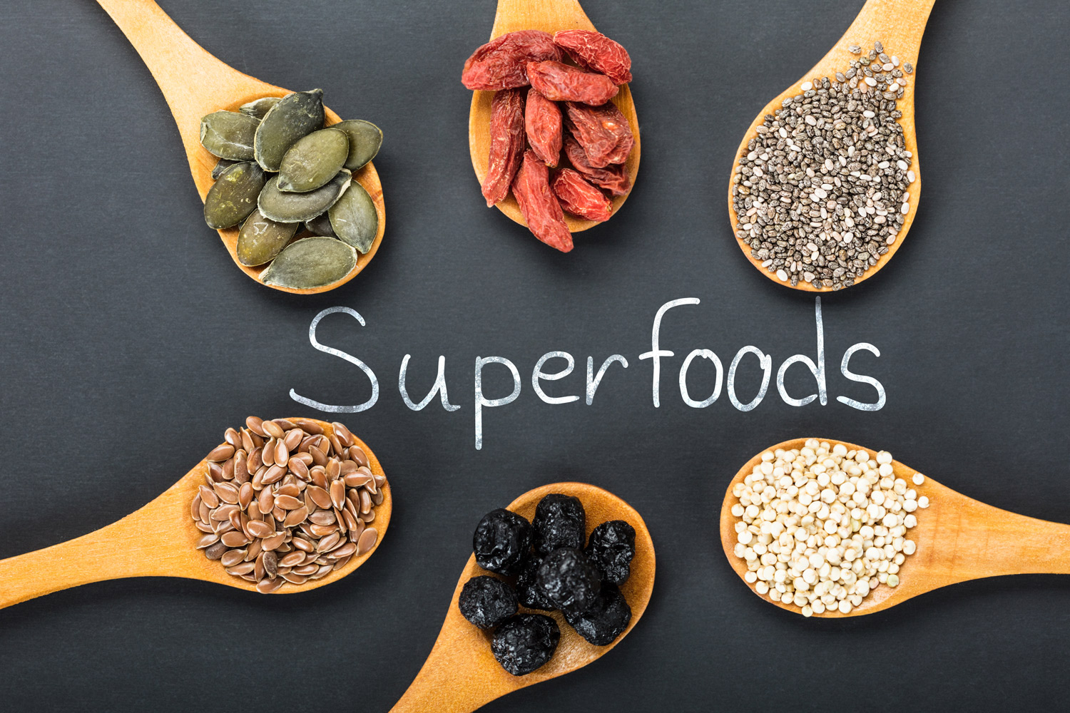 Superfoods-on-spoons-with-a-lettering-black-backround-wooden-spoons.jpg