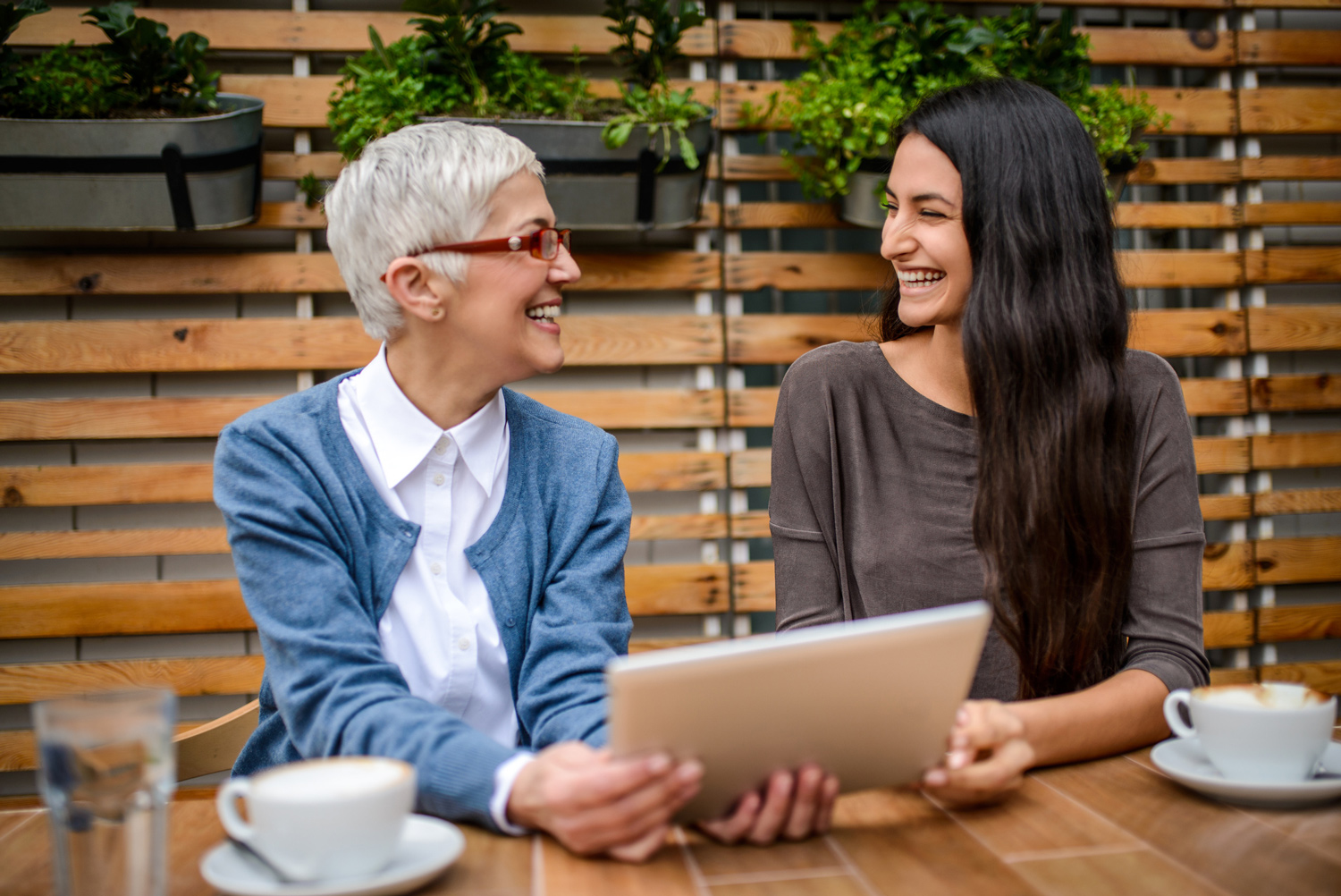 Women-mother-daughter-working-laughing-coffee-outsoors.jpg