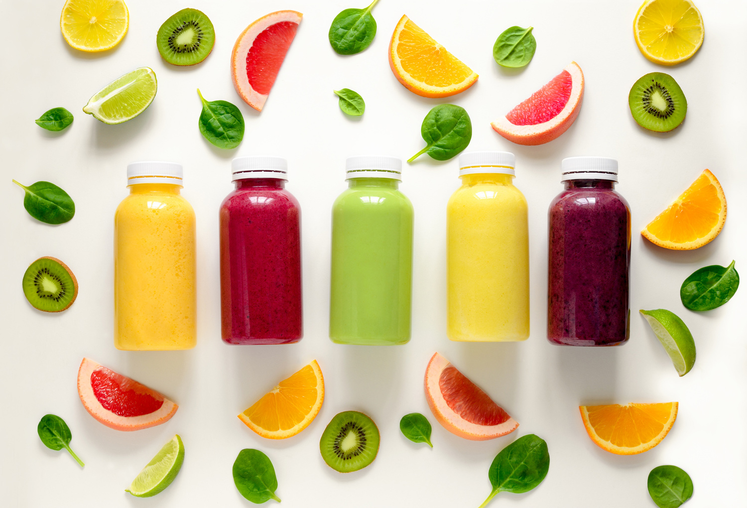 Bottles-of-juice-and-fruits-flatlay-spinach-lime-oranges.jpg