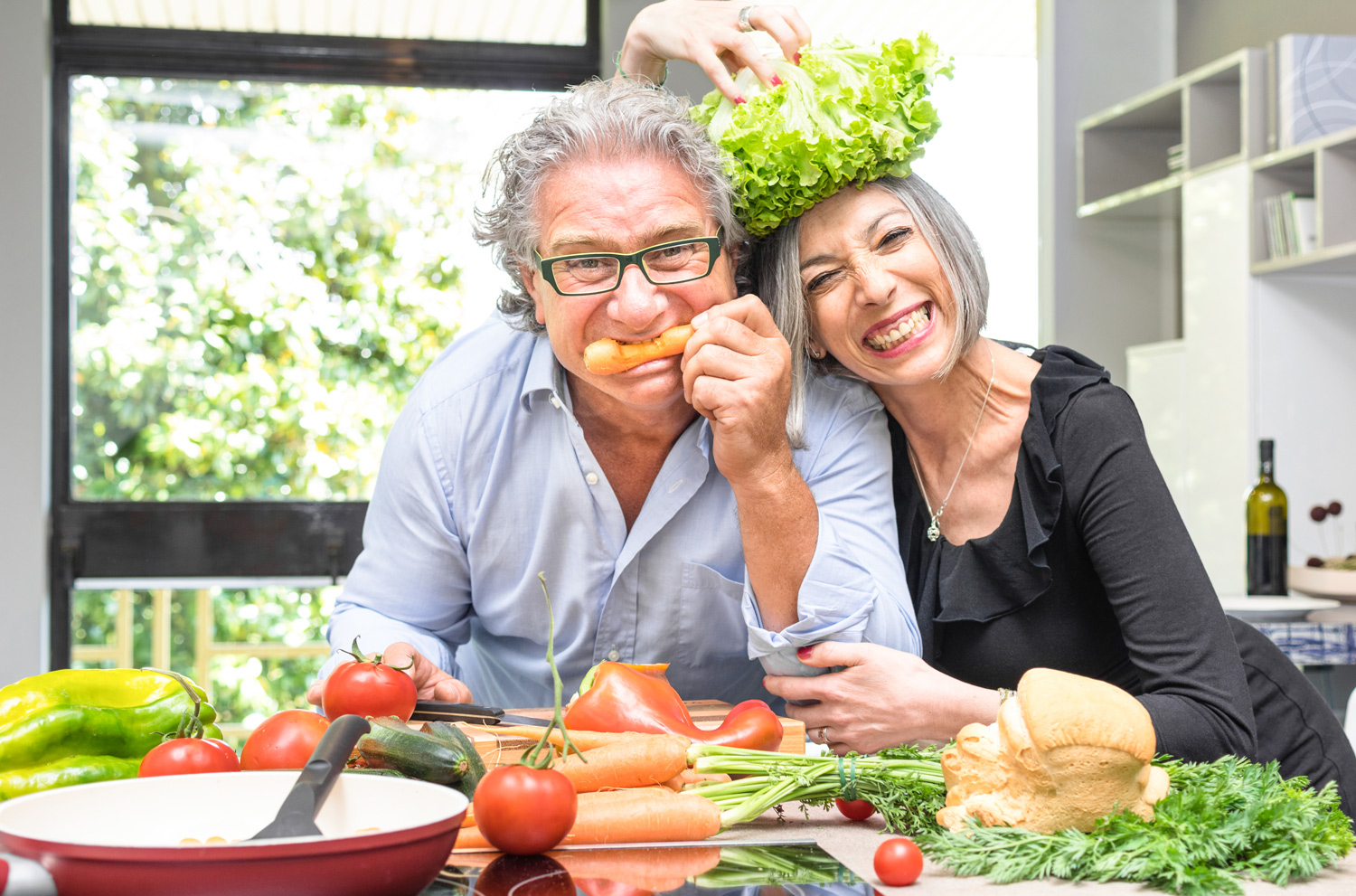 Happy-couple-with-fruits-and-vegetables-in-the-kitchen-having-fun.jpg