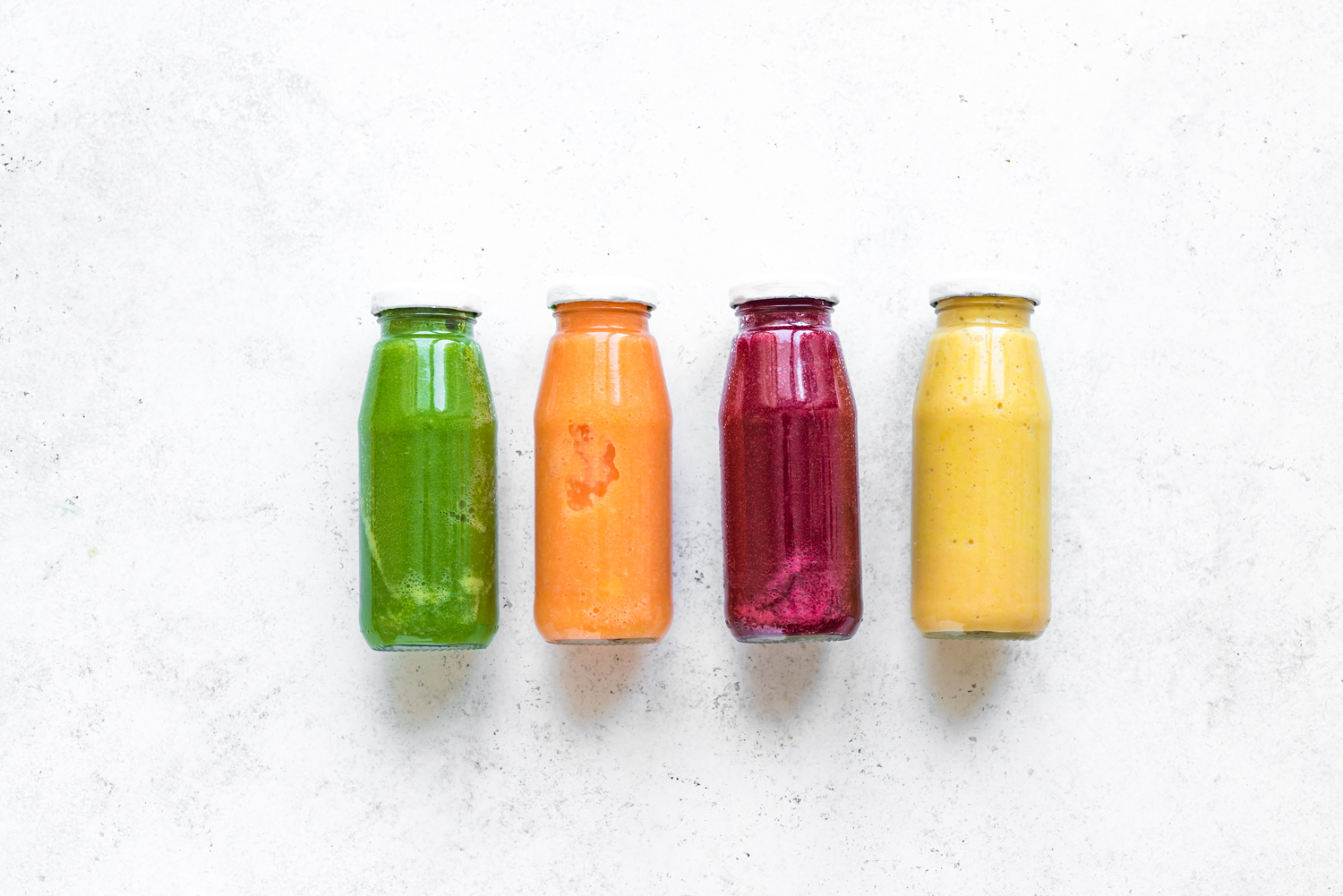 Four-colorful-bottles-of-juice-in-a-glass-bottles.jpg