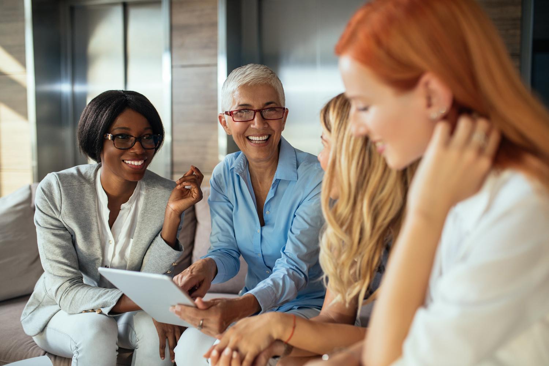 Group-of-diverse-women-mentors-entrepreneurs-meeting-happy-smiling-individuals.jpg