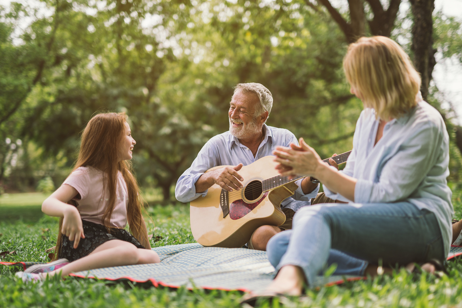 Happy-family-man-playing-guitar-wife-daughter.jpg