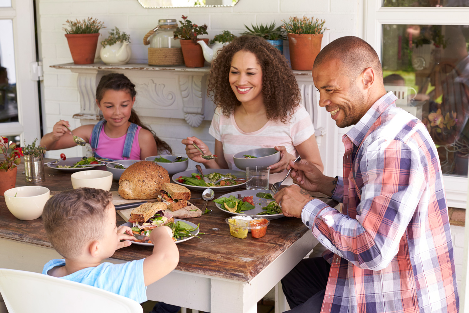 N-Family-having-healthy-meal-at-home-with-children-smiling-and-laughing.jpg