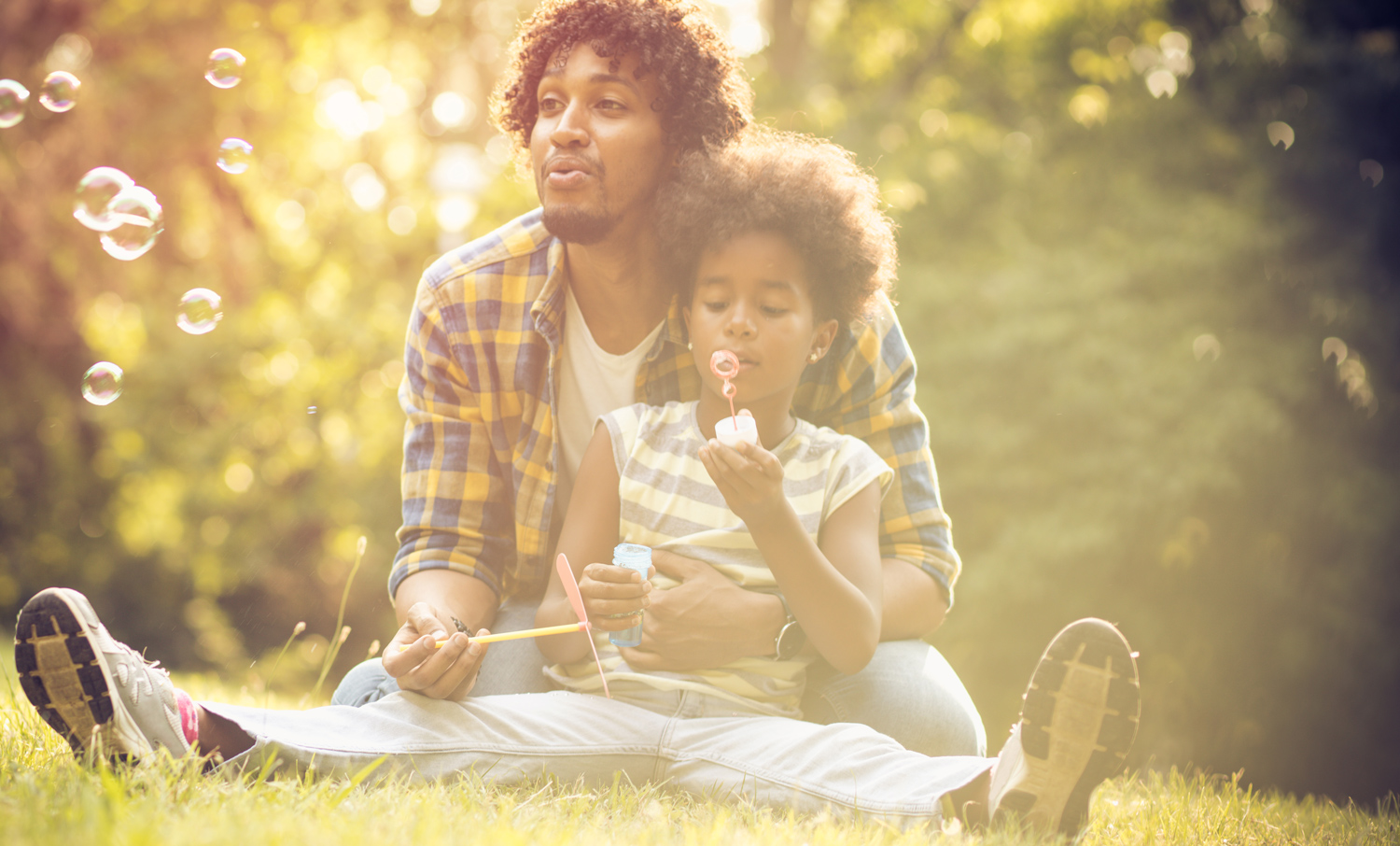 N-Father-and-daughter-spending-time-together-sitting-on-the-grass.jpg