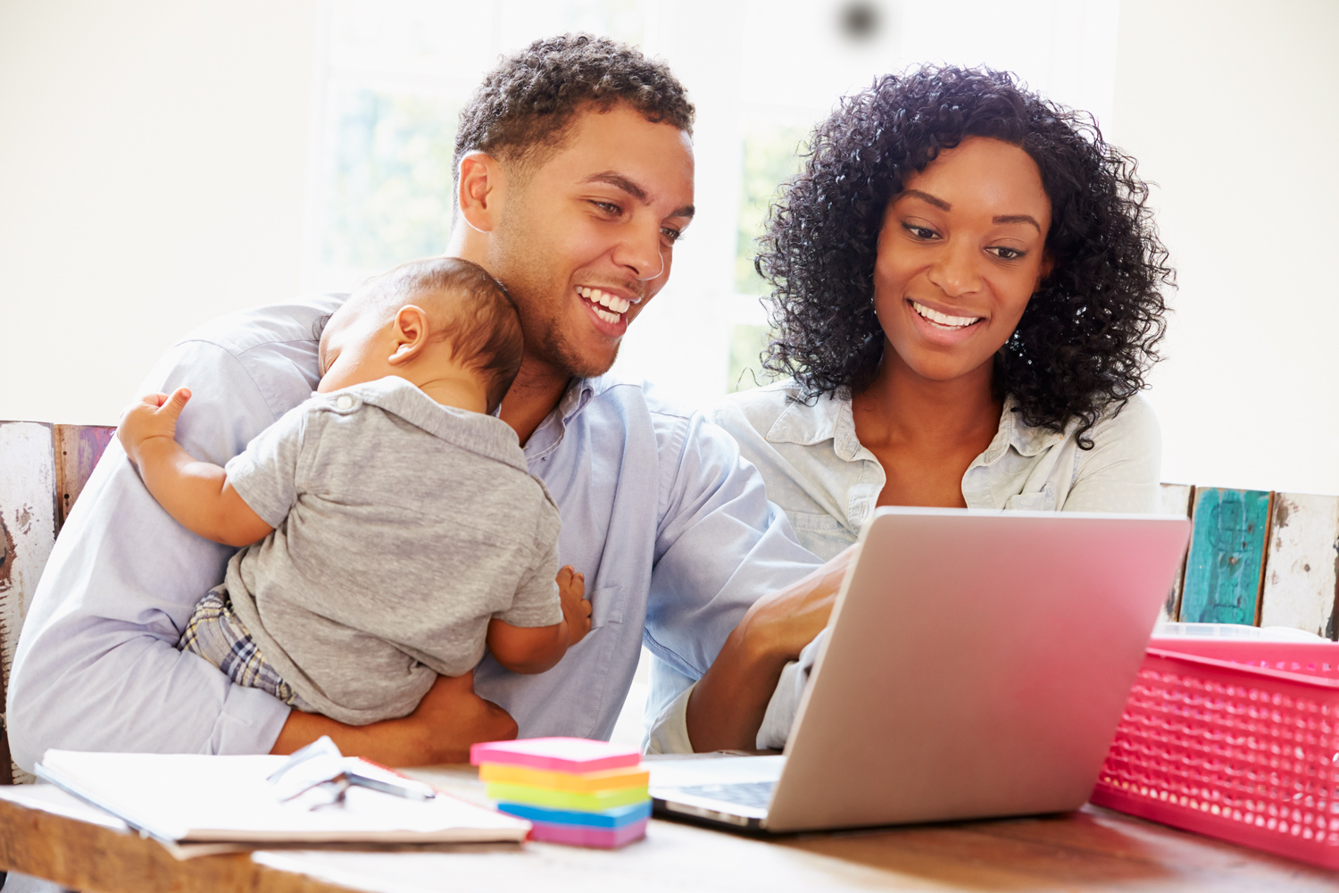 1-Parents-With-Baby-Working-In-Office-At-Home.jpg
