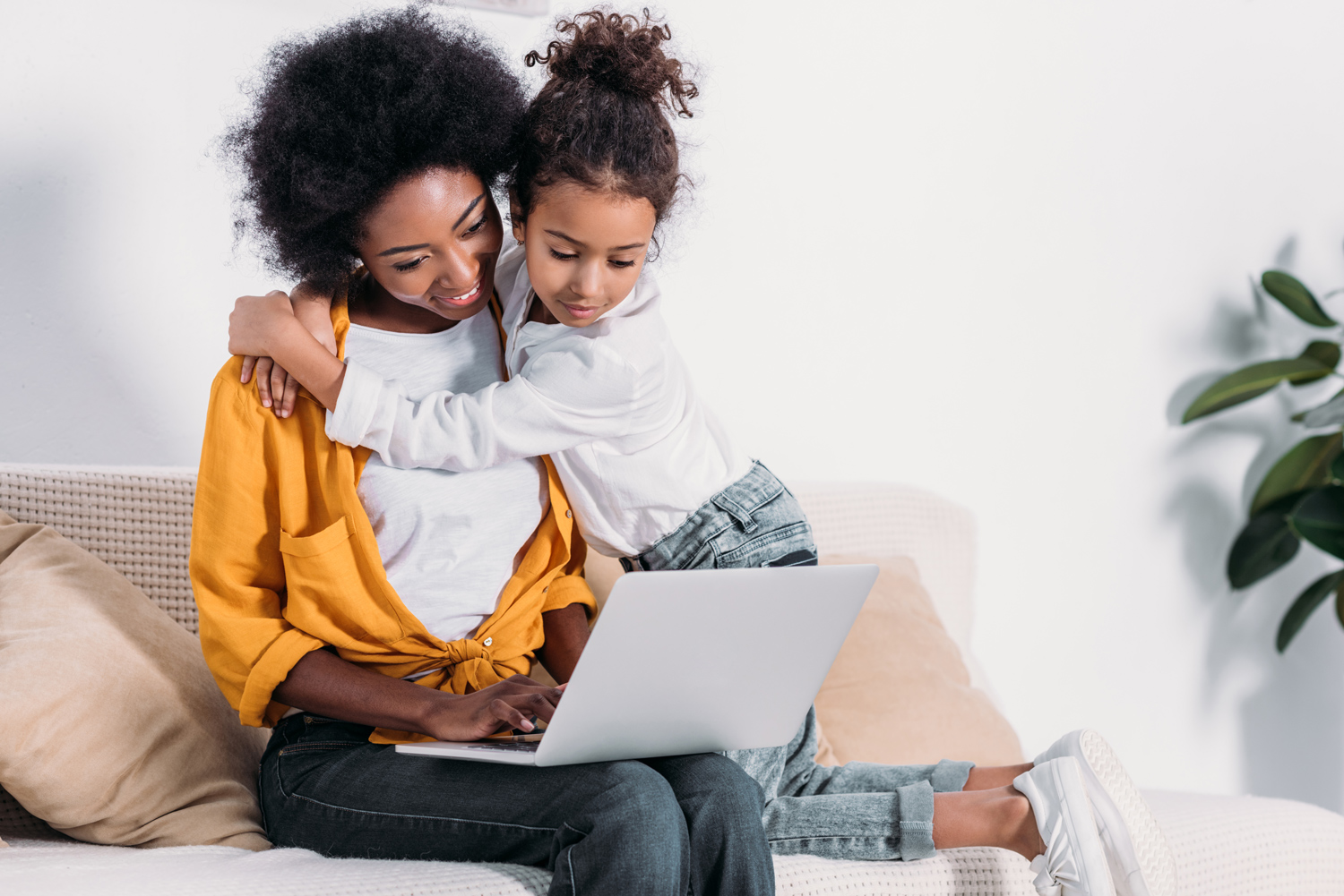 1-african-american-mother-and-daughter-watching-something-on-laptop-at-home.jpg