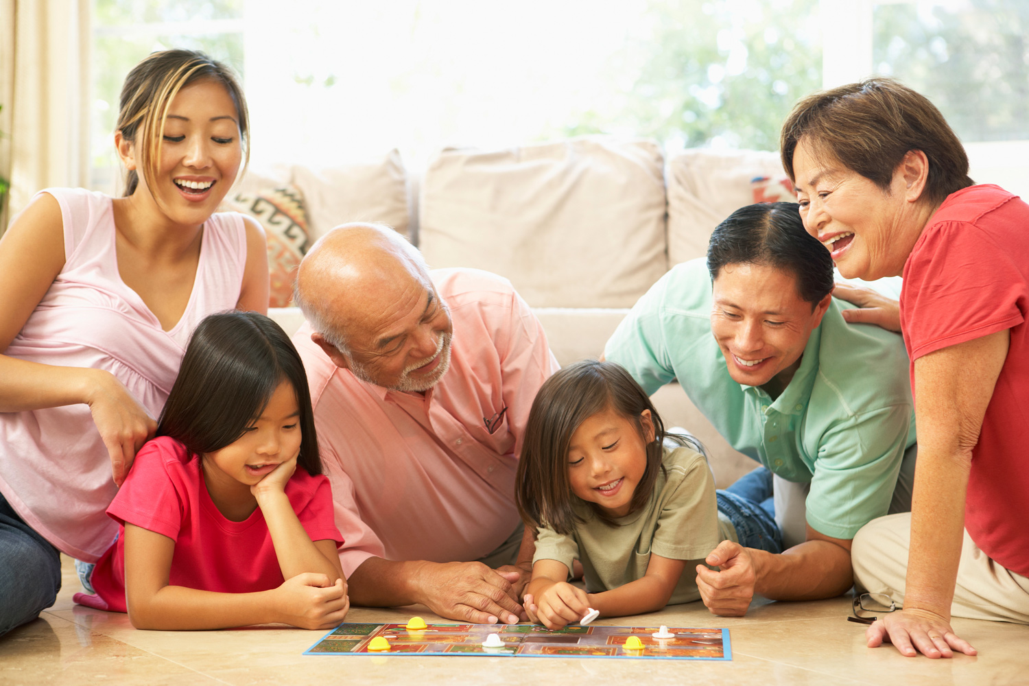 1-Extended-Family-Group-Playing-Board-Game-At-Home.jpg