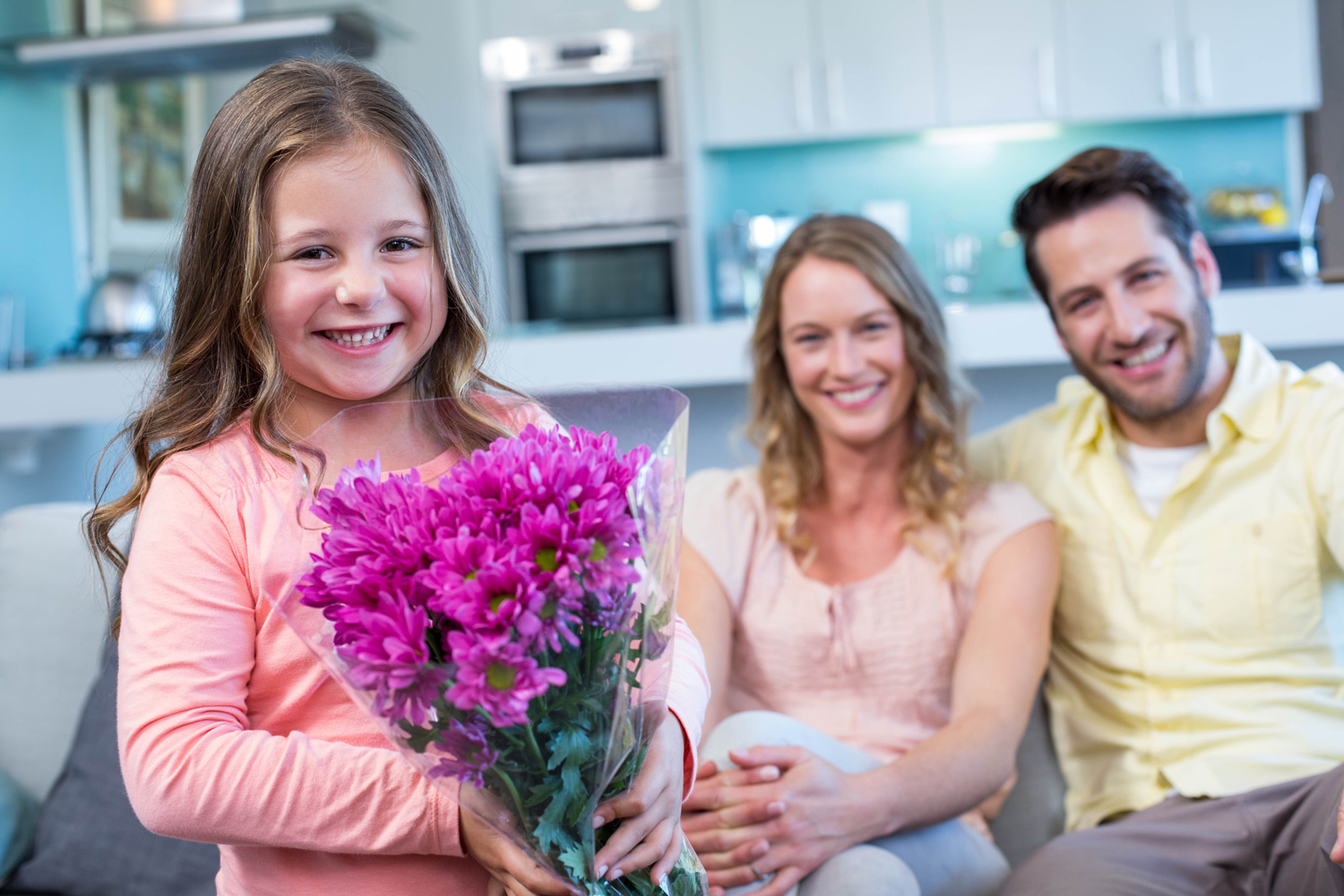 1-Daughter-surprising-mother-with-flowers.jpg