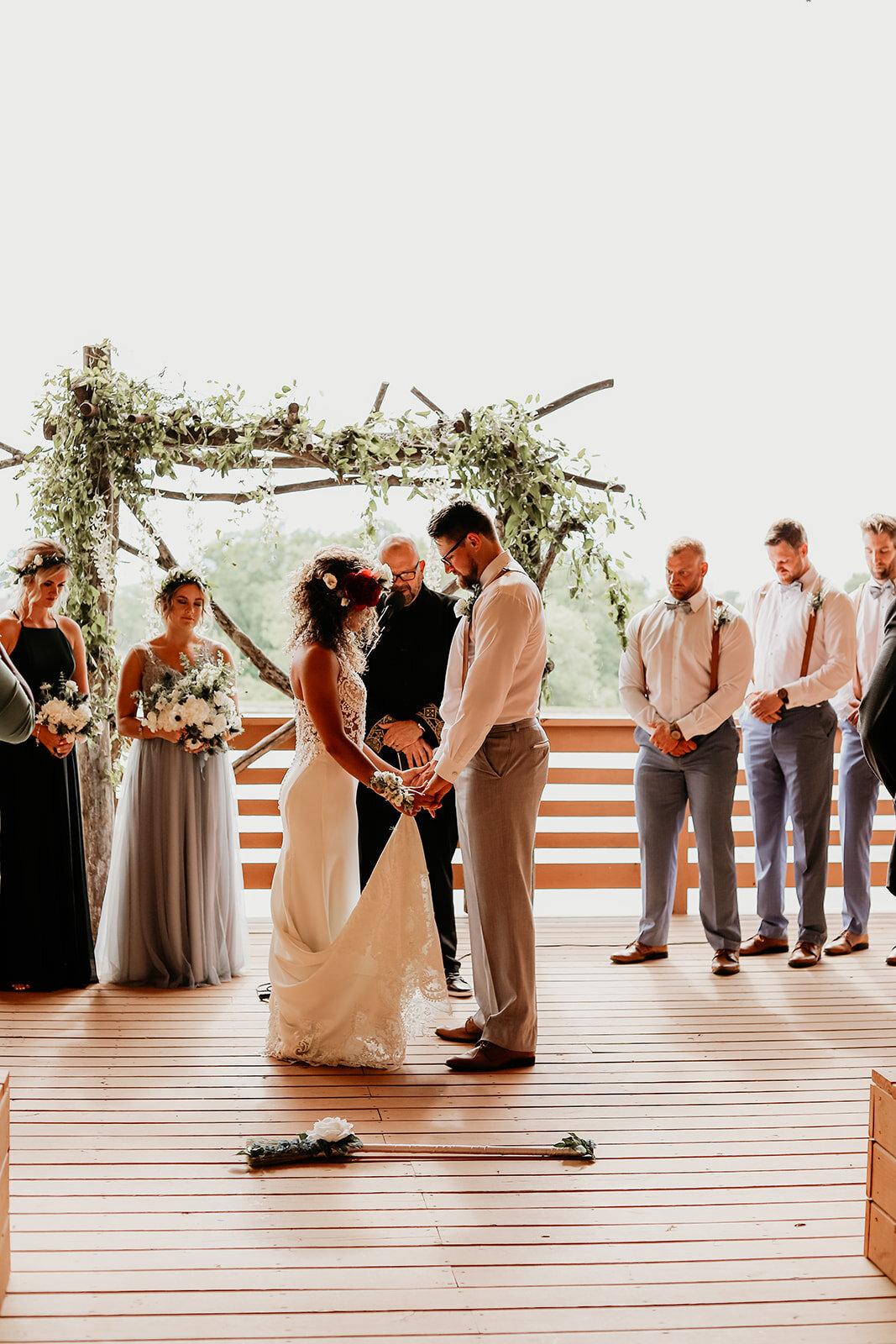 august-wolf-floral-design-des-moines-iowa-ames-wedding-florist-flowers-arch-boho-flower-crown-tattoo-jump-the-broom-suspenders-lace-dress-evergreen-bridesmaid.jpg