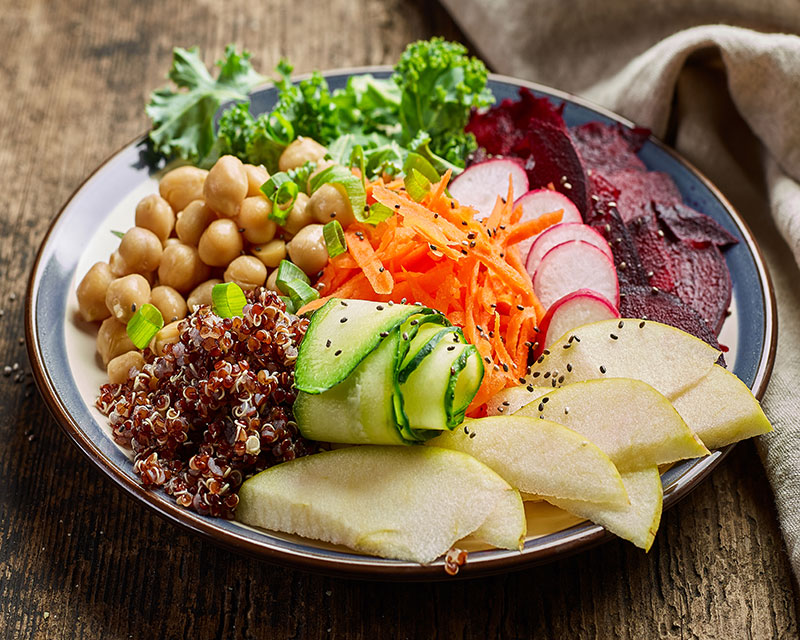 A grain bowl filled with colorful vegetables