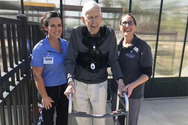 ageility-therapists-assist-an-elderly-man.jpg