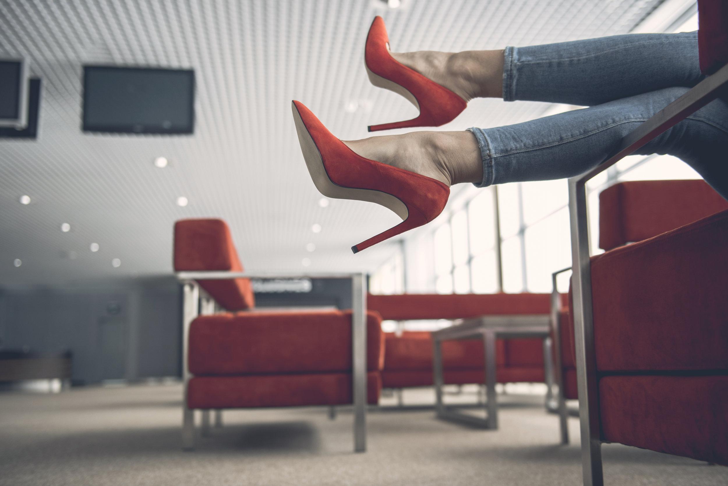 Woman-feet-locating-in-modern-lounge-zone-955686628_6016x4016.jpeg
