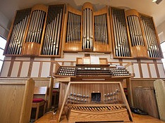 The Pipe Organ - The pipe organ was installed by Wilson and Associates of Colorado Springs in August 2003.  The organ was dedicated in June 2004.  A number of parishioners aided Music Director Emeritus Trent Ellis in purchasing and assembling its components, including the hand-fashioned decorative wood casing.