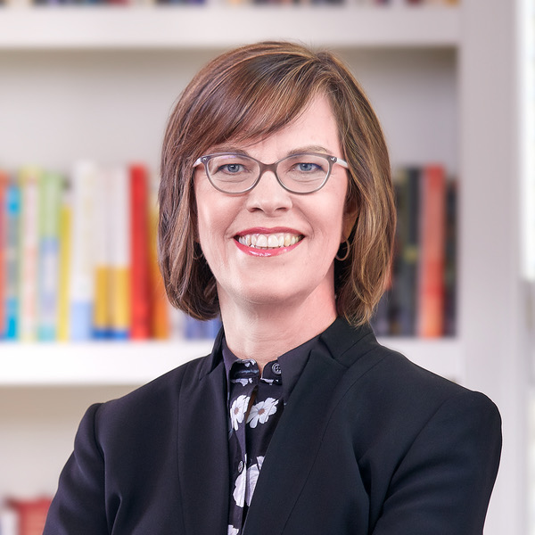 The lady is Cheryl Bachelder, the former CEO of Popeye's, stepped down in 2017 when Restaurant Brands International bought the chain (they also own Tim hortons and Burger King). Her salary was north of $3M/yr.