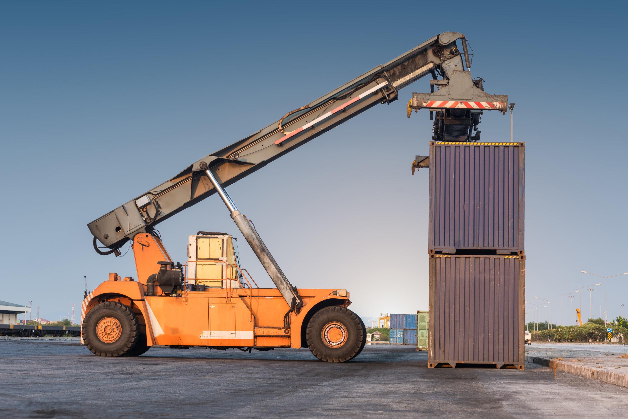 forklifthandlingholdingcontainerbox.jpg