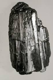 Black Tourmaline -  Protects agains electromagnetic smog, radiation, psychic attack, and negative energies of all kind. Grounds energy and increases physical vitality, disperses tension and stress. Helps with an attitude of objective neutrality with clear, rational thought processes. Encourages positive attitude no matter what the circumstances.