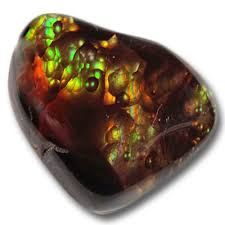 Fire Agate -  Calming and Grounding energy, bringing security and safety, especially during difficult times. Strong protective stone, especially against others wishing the keeper ill will. Returns harm back to its source so that the source understands the harm it is doing. Links to the fire element and aids sexual endeavors. Stimulates vitality on all levels. Brings up inner problems for resolution. Elinimates cravings and destructive desires (helpful for treating addictions). Heals the stomach, nervous, endocrine, & circulation systems. Helps clairfy vision at all levels (spiritual, emotional, physical). Reduces hot flashes.