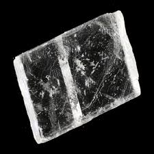 Icelandic Spar -  (Optical Calcite) Amplifies images and heals the eyes. Aids in seeing the double meaning hidden behind words. Reduces tension that causes migraines.