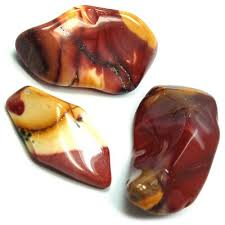 Mookaite -  (Australian Jasper) Provides a balance between inner and outer experiences. Imparts a desire for new experiences and gives a deep calm to help experience them. Points out all possibilities in difficult situaions. Pysically stabilizing stone; helpful for people who have a difficult time grounding. Heals wounds and purifies the blood.