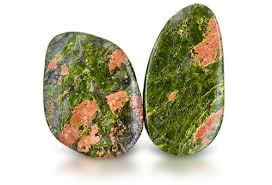 Unakite -  It brings one's consciousness to the present. Also acts to balance the emotional body. Bring it into alignment with the higher forces of spirituality. Can help one deal with the past.