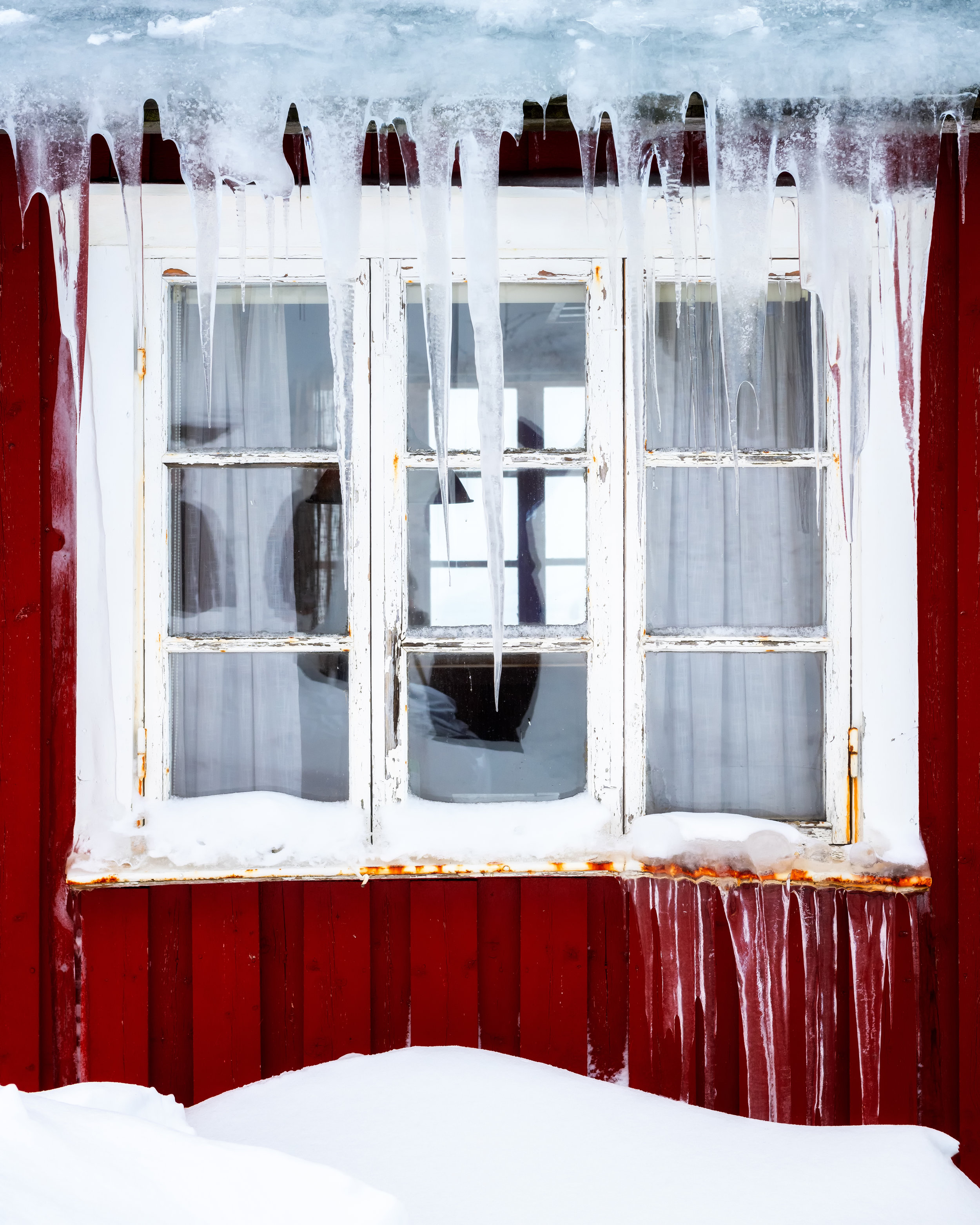 Icicles on a robu window, Hamnøy.