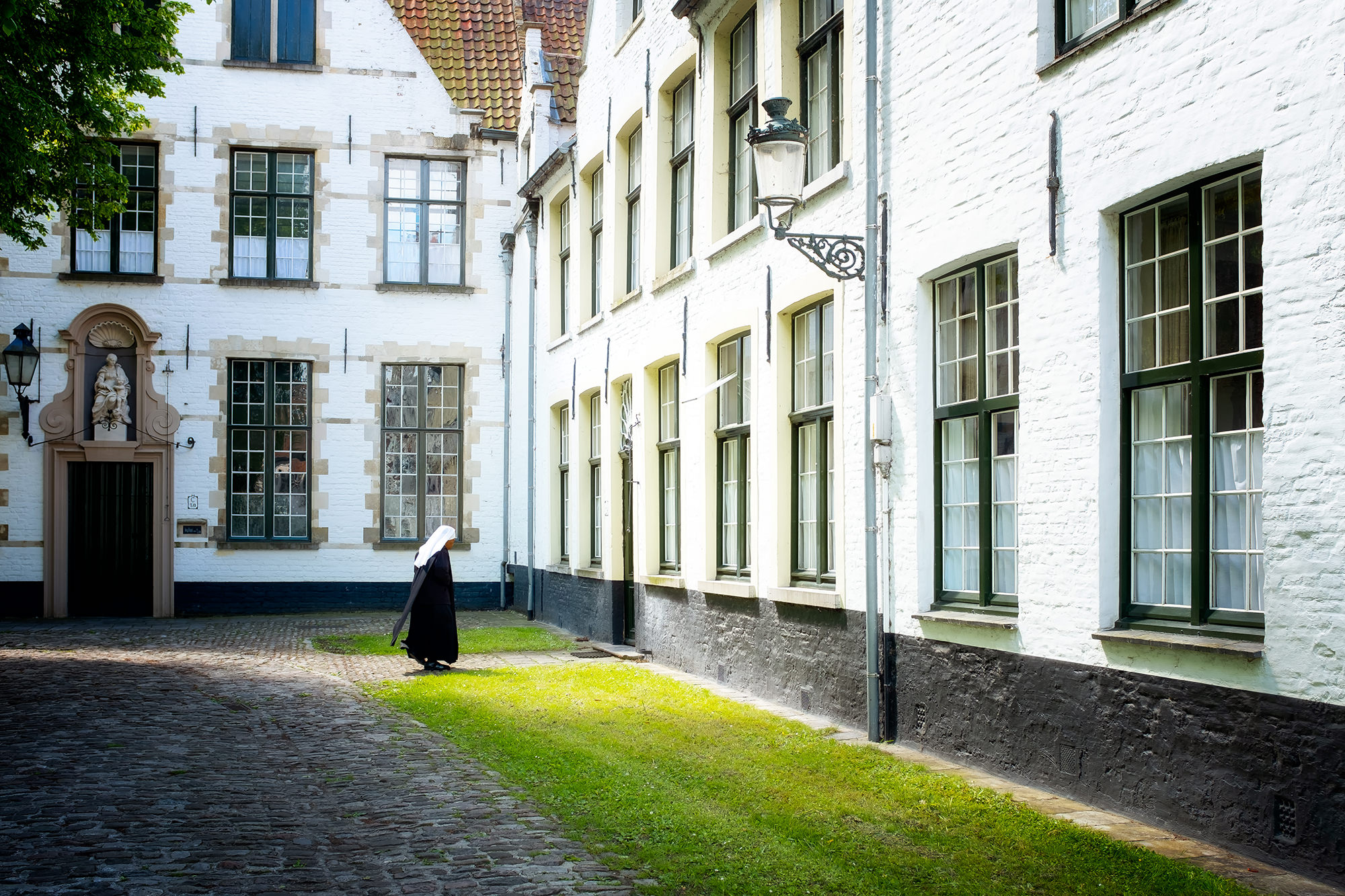 Nun of the Begijnhof convent   Click image to enlarge