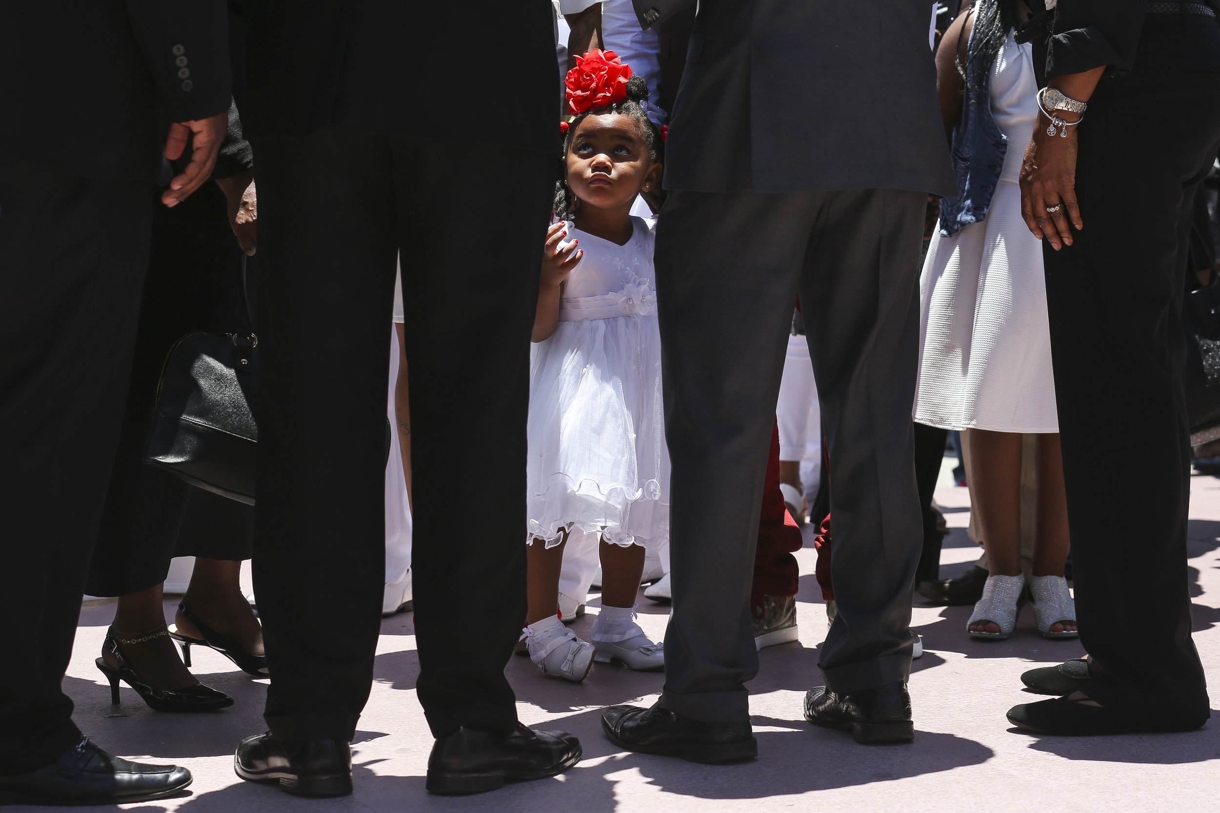 Tedrika King, 2, waits outside before the start of a funeral service for her 13-year-old sister, Tedra King, at Second Baptist Church in Richmond Heights on Saturday, May 6, 2017. Tedra King was a victim to gun violence after being accidentally shot by her 17-year-old brother, Martaevious Santiago.