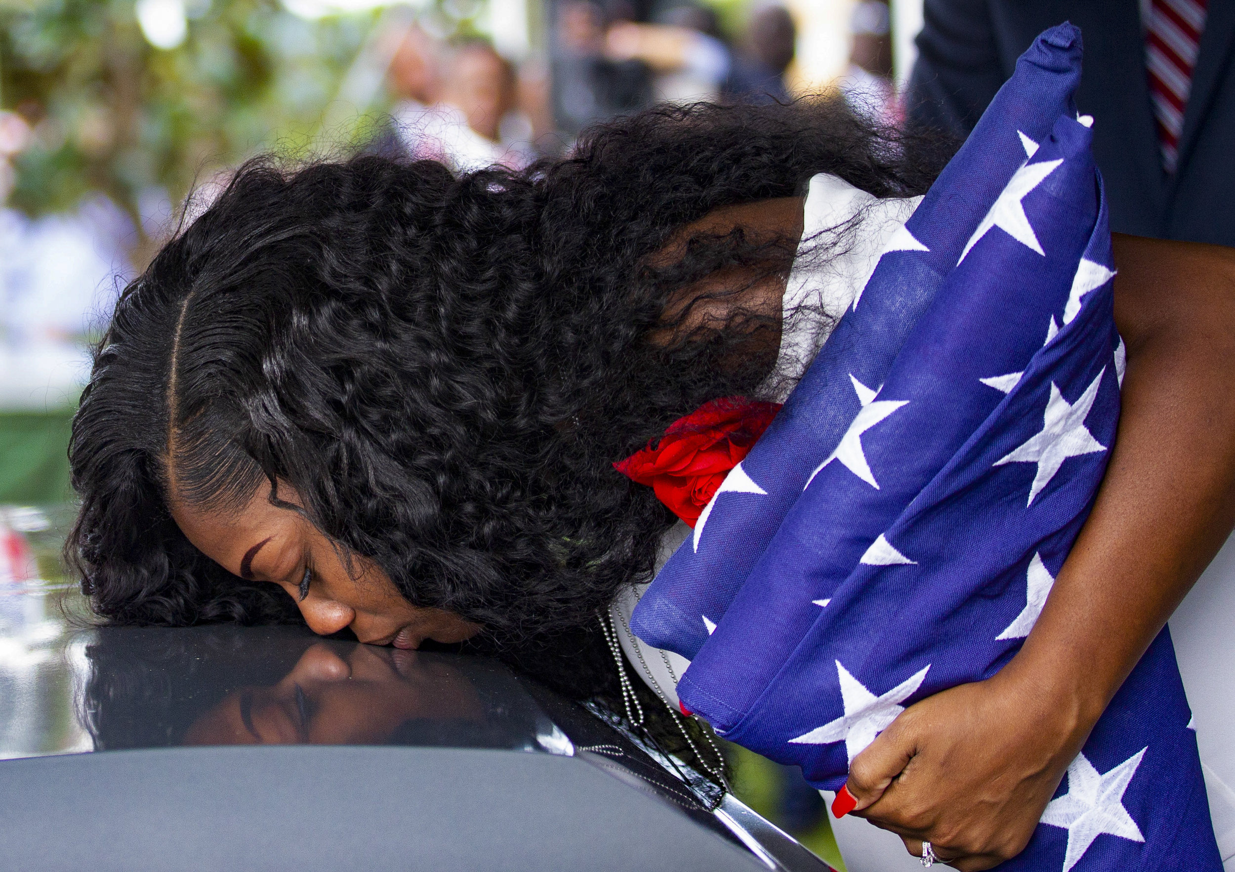 Myeshia Johnson kisses the casket of her husband, Sgt. La David Johnson, during his burial service at Fred Hunter's Hollywood Memorial Gardens in Hollywood, Florida on Saturday, October 21, 2017.