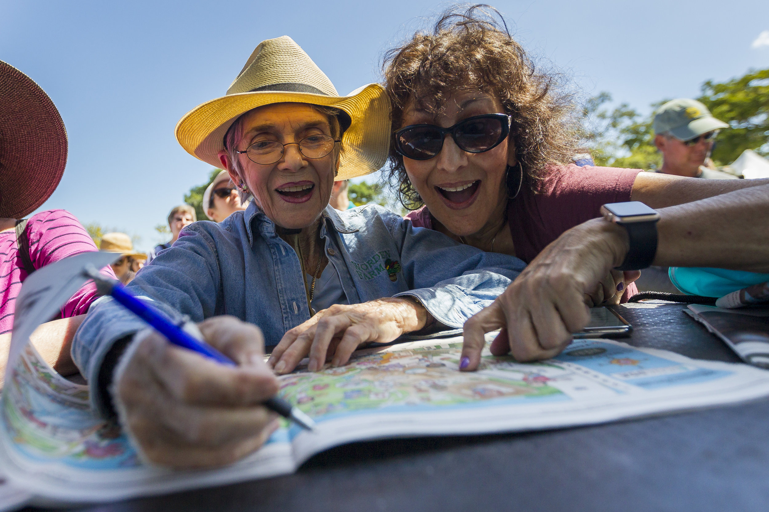 Pepi Granat, left, and her friend, Karen Shane, write down clues during the 2018 Herald Hunt at Museum Park in downtown Miami on Sunday, March 4, 2018.