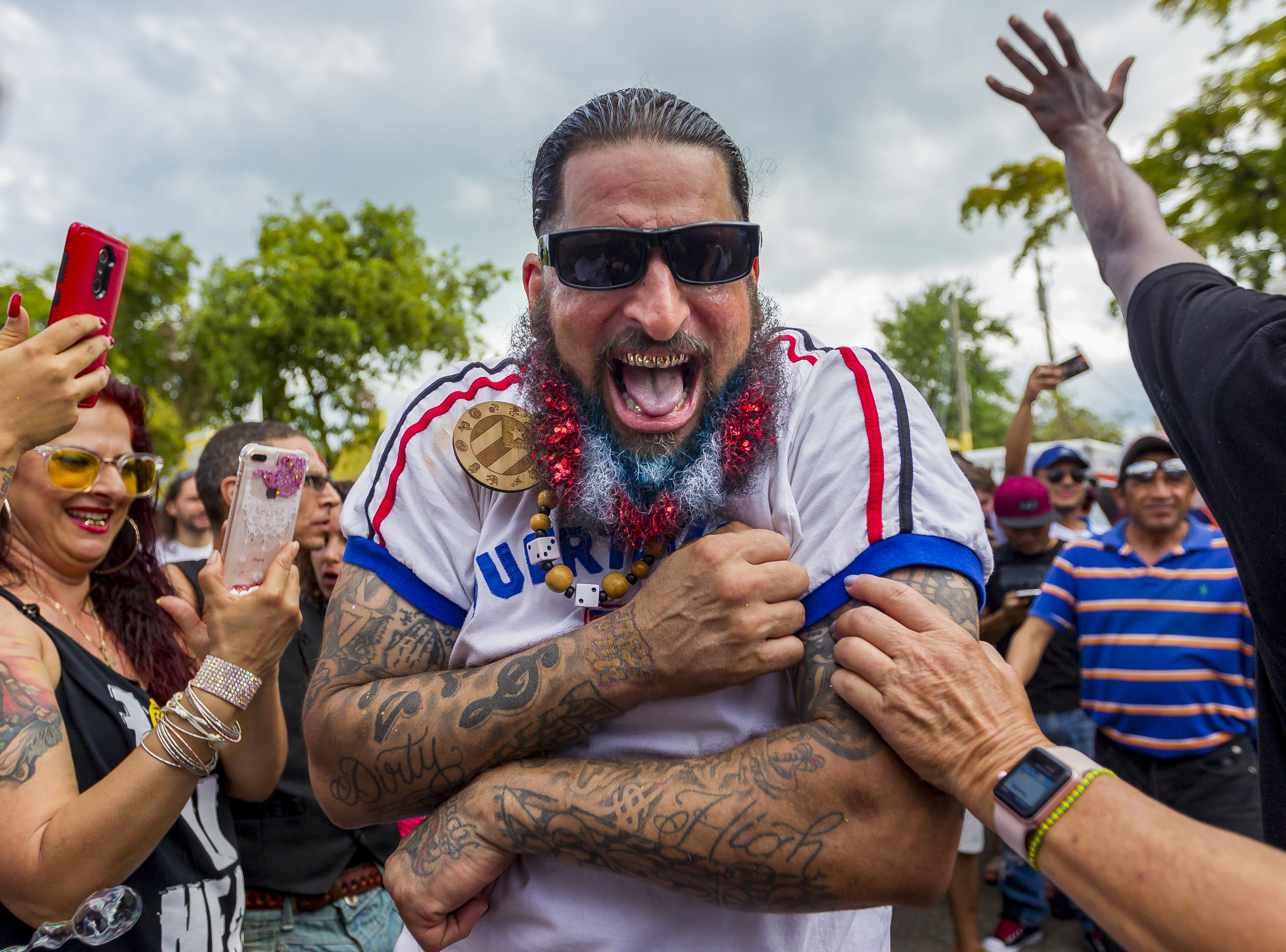 Vince Colon dances in the middle of a crowd during the Carnival Miami Calle Ocho festival in Little Havana on Sunday, March 11, 2018.