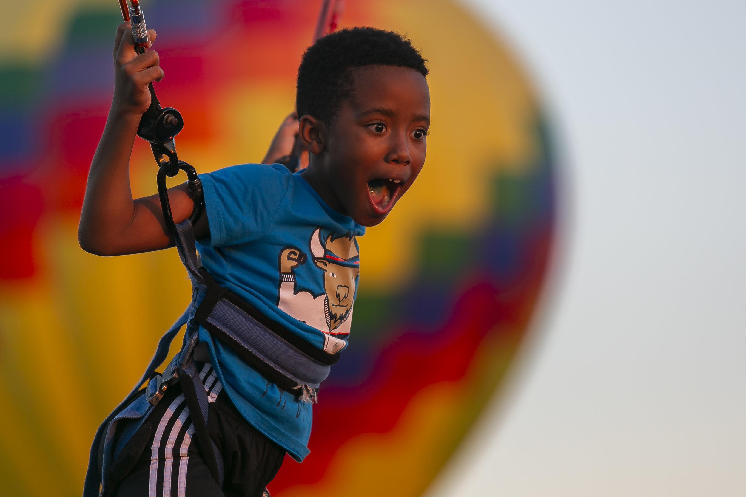 Dax, 9, reacts while riding a bungee trampoline during the Homestead Miami Balloon Glow on March 2, 2019, near the Homestead-Miami Speedway in Homestead, Florida.