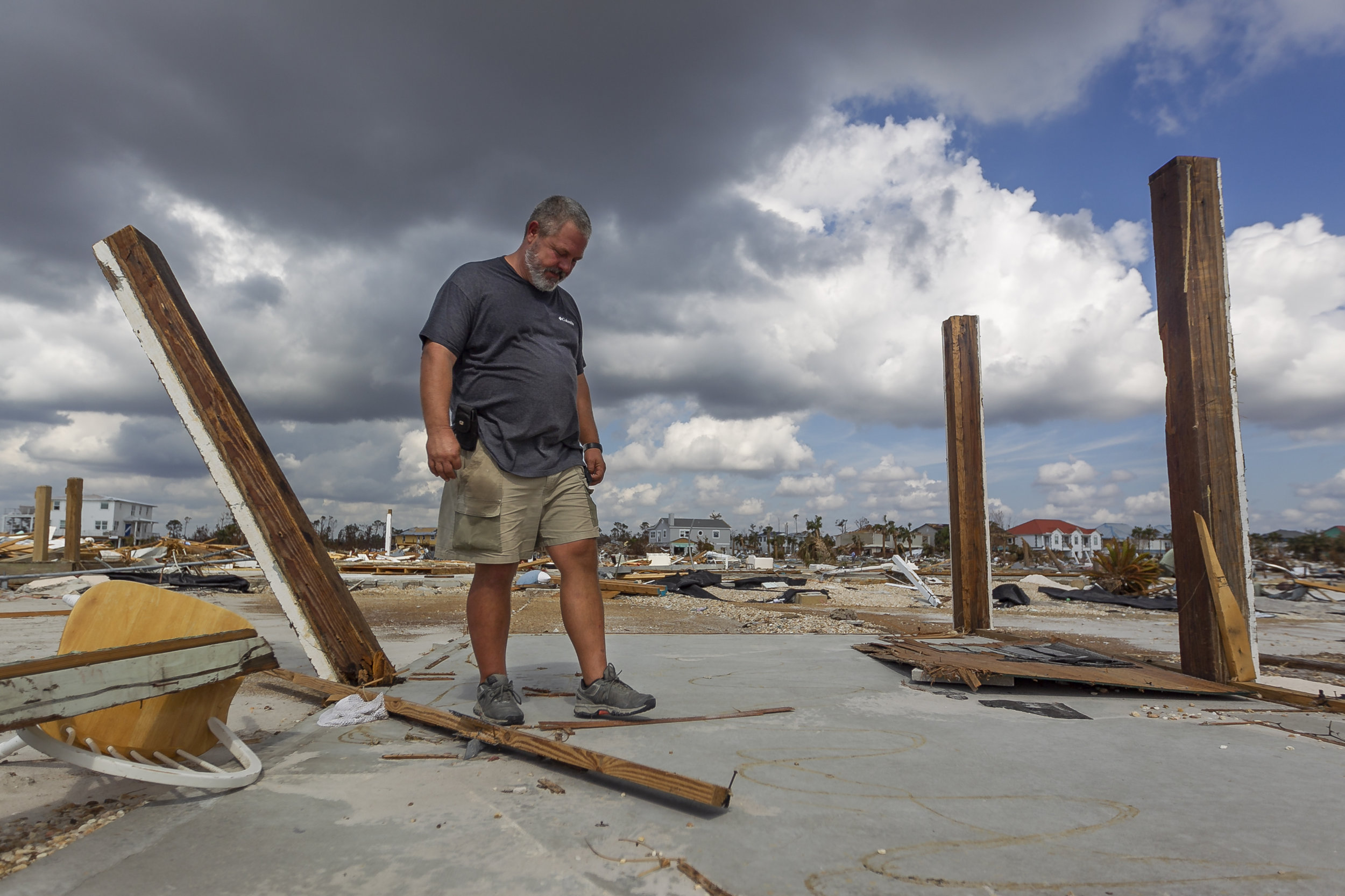 Joe Rodgers, 46, a wholesale produce salesman, surveys the remains of his rental duplex in Mexico Beach, Florida on Friday, October 19, 2018. Hurricane Michael devastated the Florida Panhandle leaving tens of thousands without food, power or shelter.