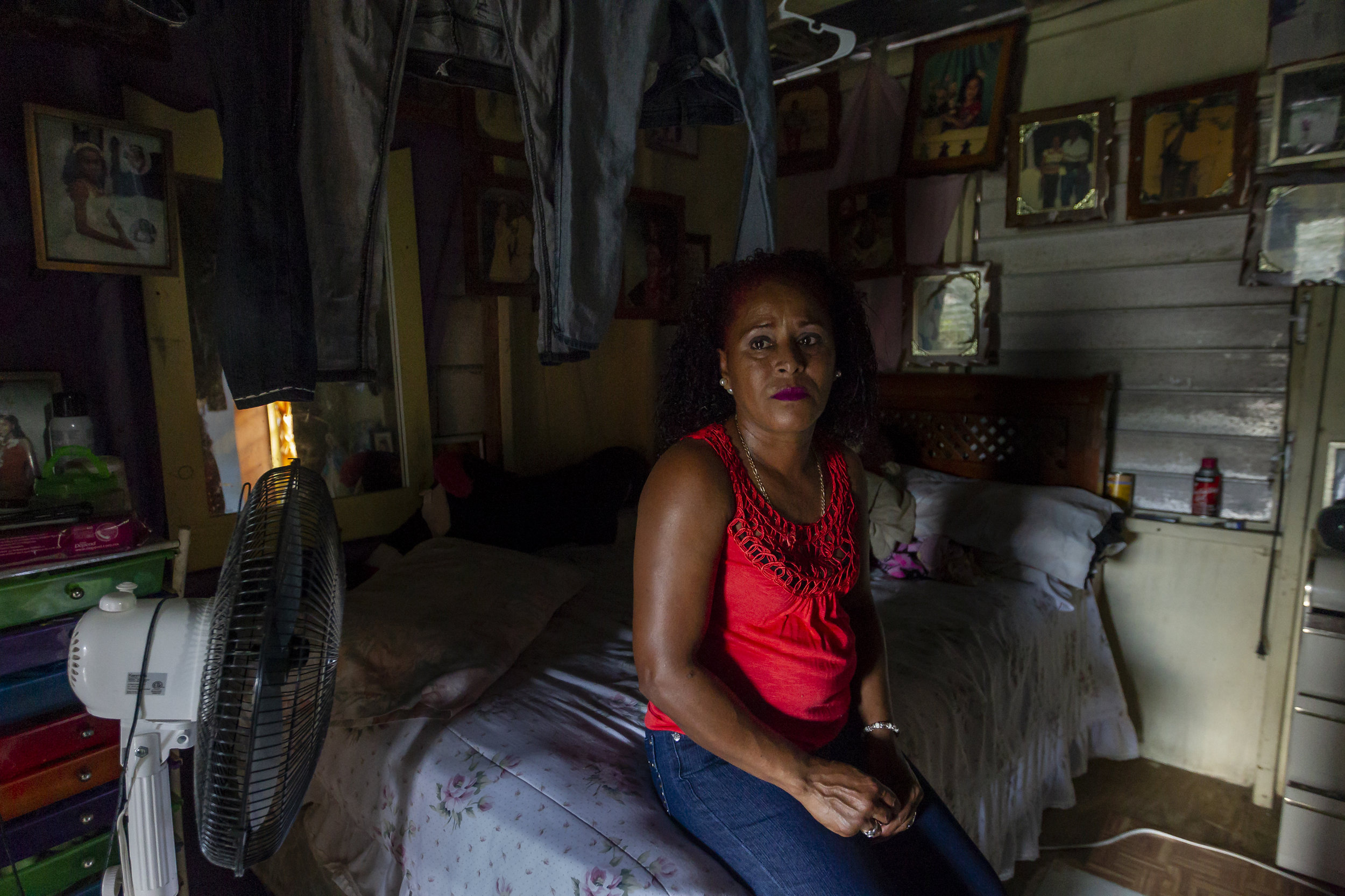 Merry Perez Colon, 51, lives in a damaged home with four family members in La Juncia community of Comerío, Puerto Rico on August, 25, 2018. Perez Colon and her family were denied federal disaster aid.