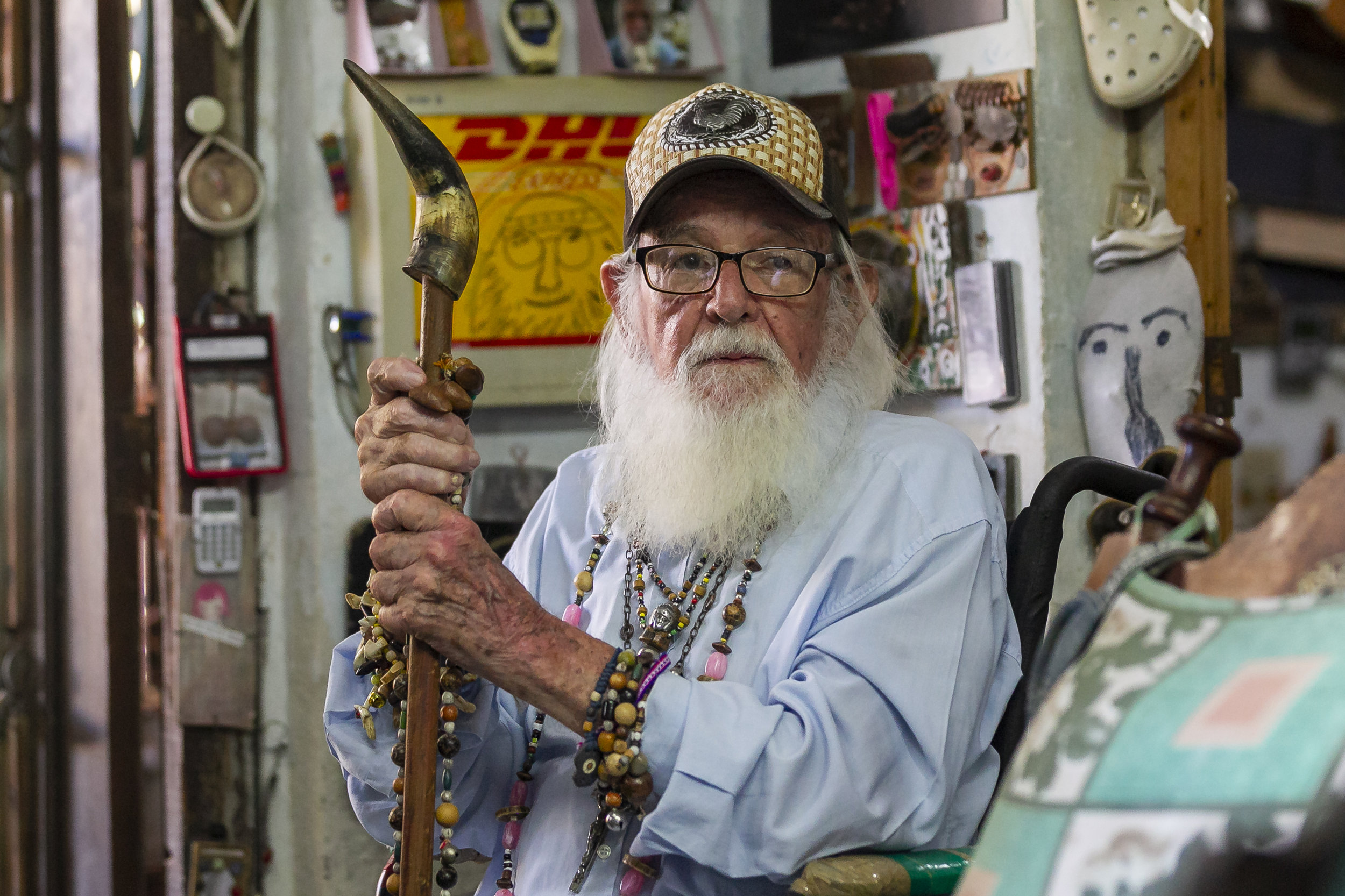 """Héctor Pascual """"Gallo"""" Portieles, 94, a Cuban outsider artist, explains that he never sells his work, he creates art from found objects to feed people's spirits. In his house in Alamar, on the eastern outskirts of Havana, Portieles has thousands of pieces of art he has created from cast-off objects."""