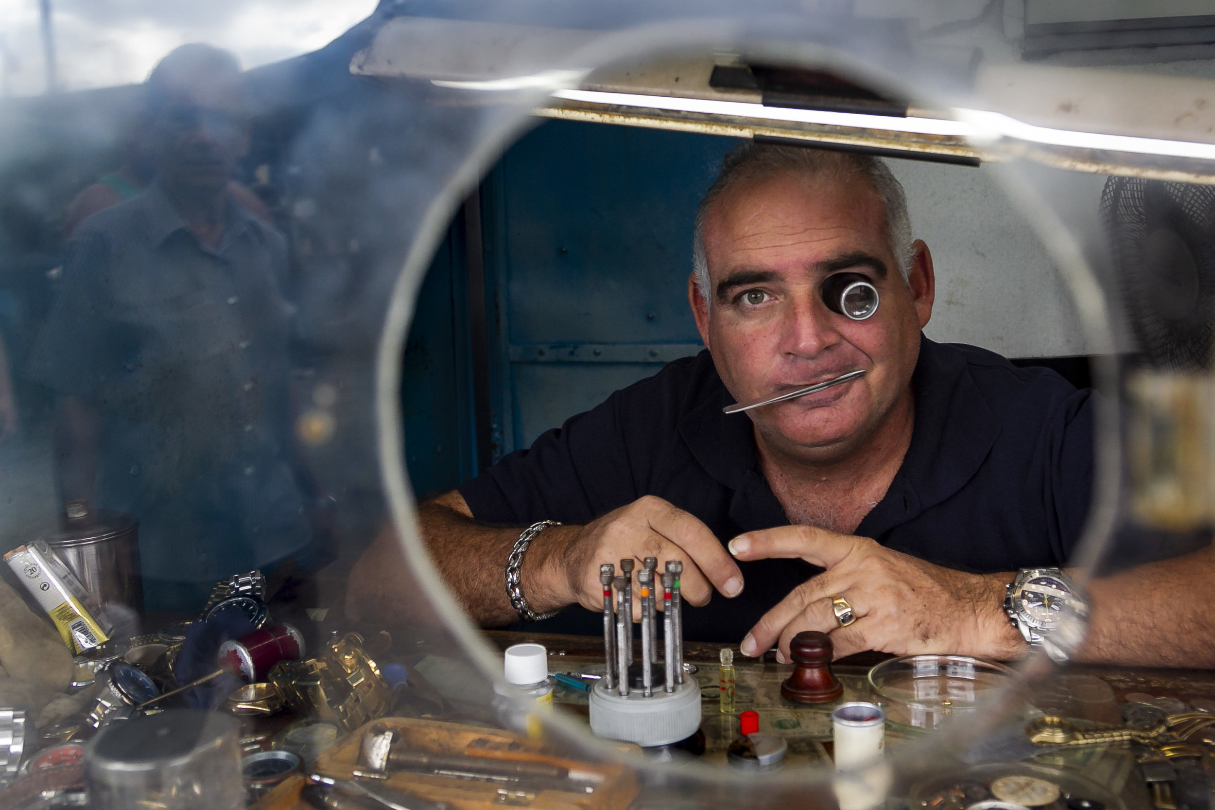 Carlos Ignacio Romero fixes watches at the Virgen del Camino market on the outskirts of Havana, Cuba on November 16, 2018. New regulations that put more restrictions on Cuba's self employed sector are going in affect December 7, 2018.