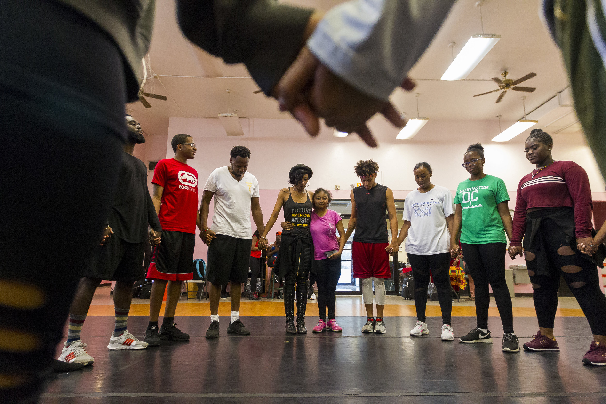 Entourage finalists talk in a group after their rehearsal session at the African Heritage Cultural Arts Center in Liberty City on Saturday, April 14, 2018. Entourage's chosen artists are given a variety of classes that help transform and develop their talent.