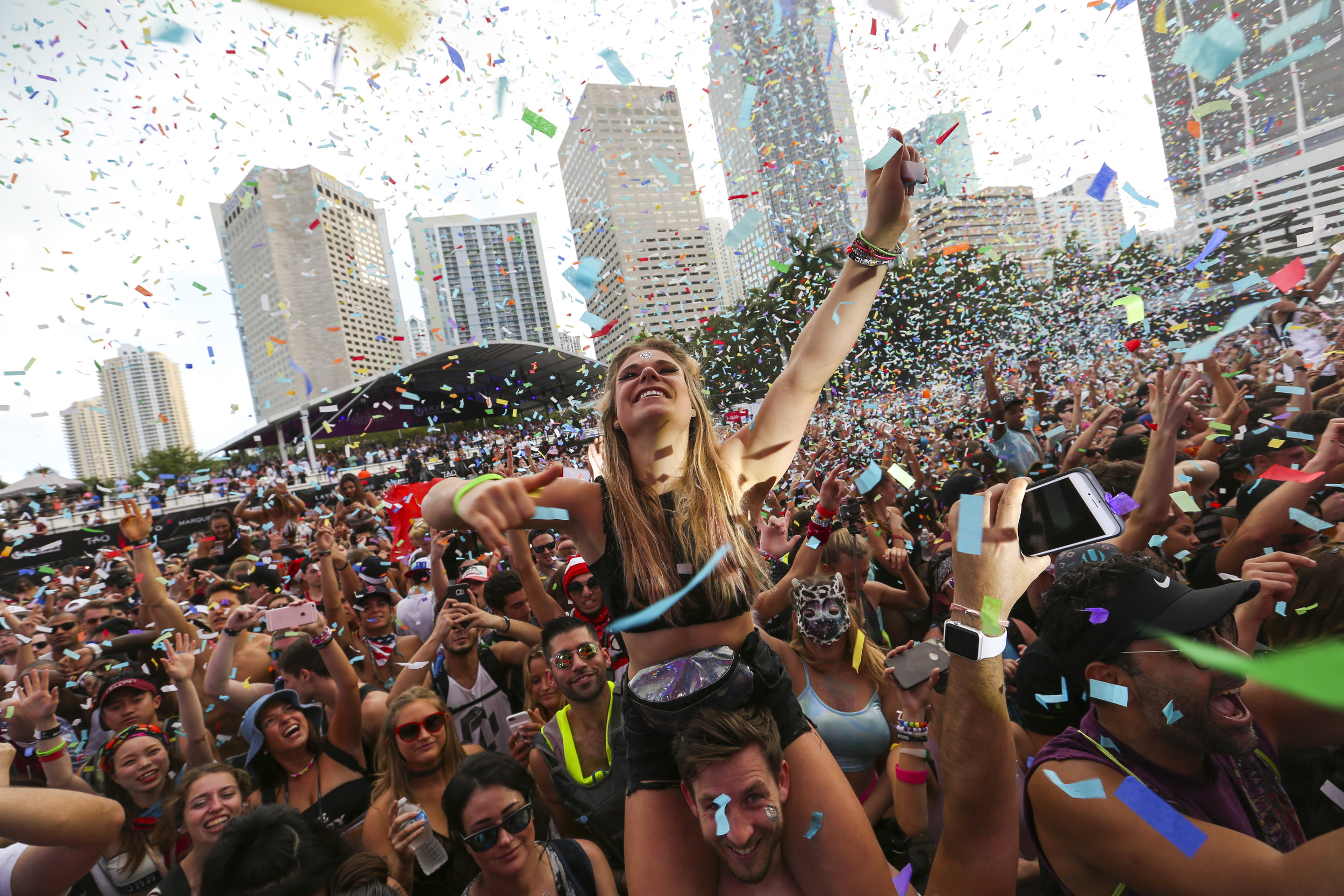 Alina Baum, 24, from Germany, dances as confetti sprinkles the crowd during the third day of Ultra Music Festival in downtown Miami on Sunday, March 26, 2017.