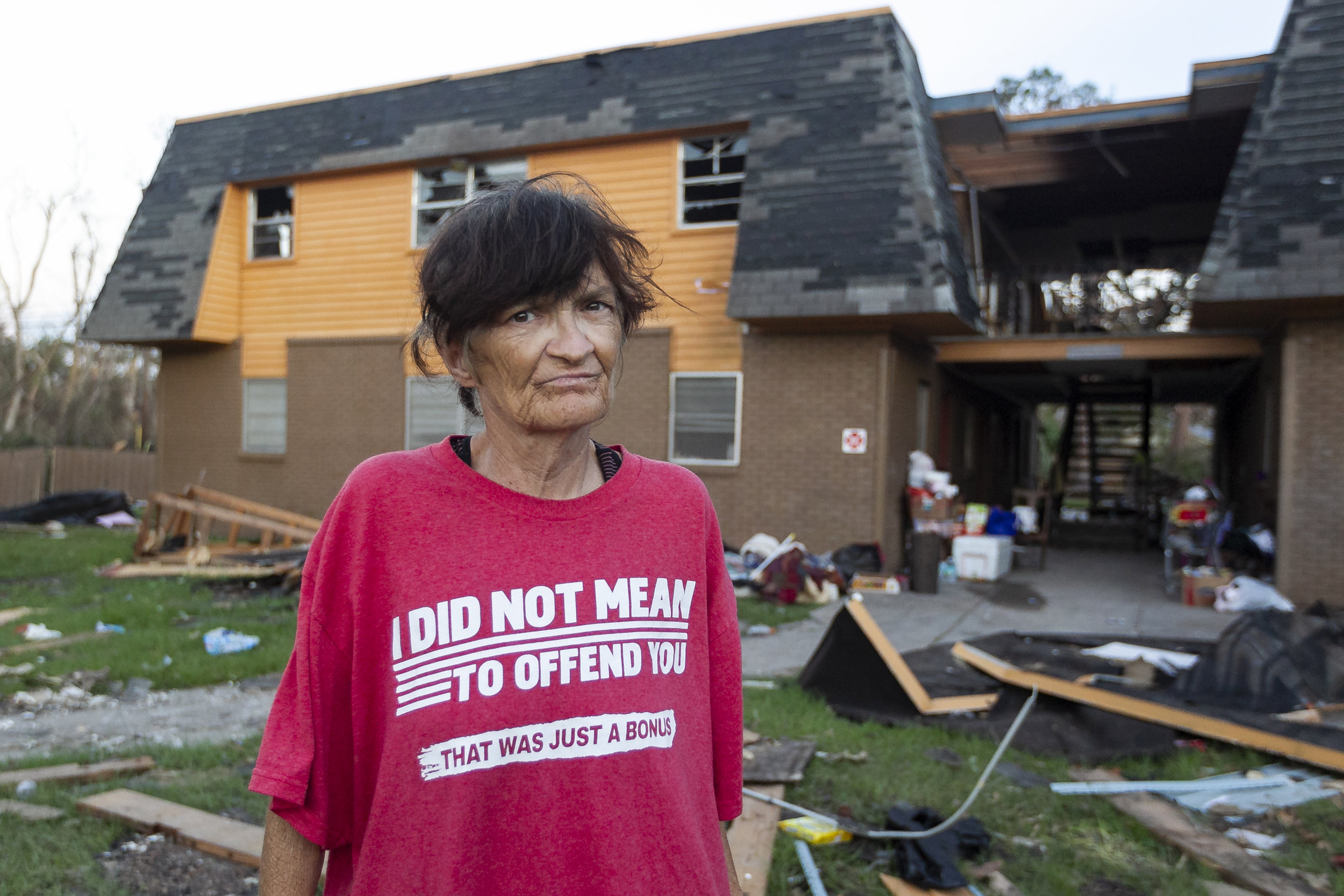 Lorraine DePriest, 55, who suffers from many medical issues, stands outside of her former home in a public housing complex in Panama City, Florida on Friday, October 19, 2018. Hurricane Michael devastated the Florida Panhandle leaving tens of thousands without food, power or shelter.